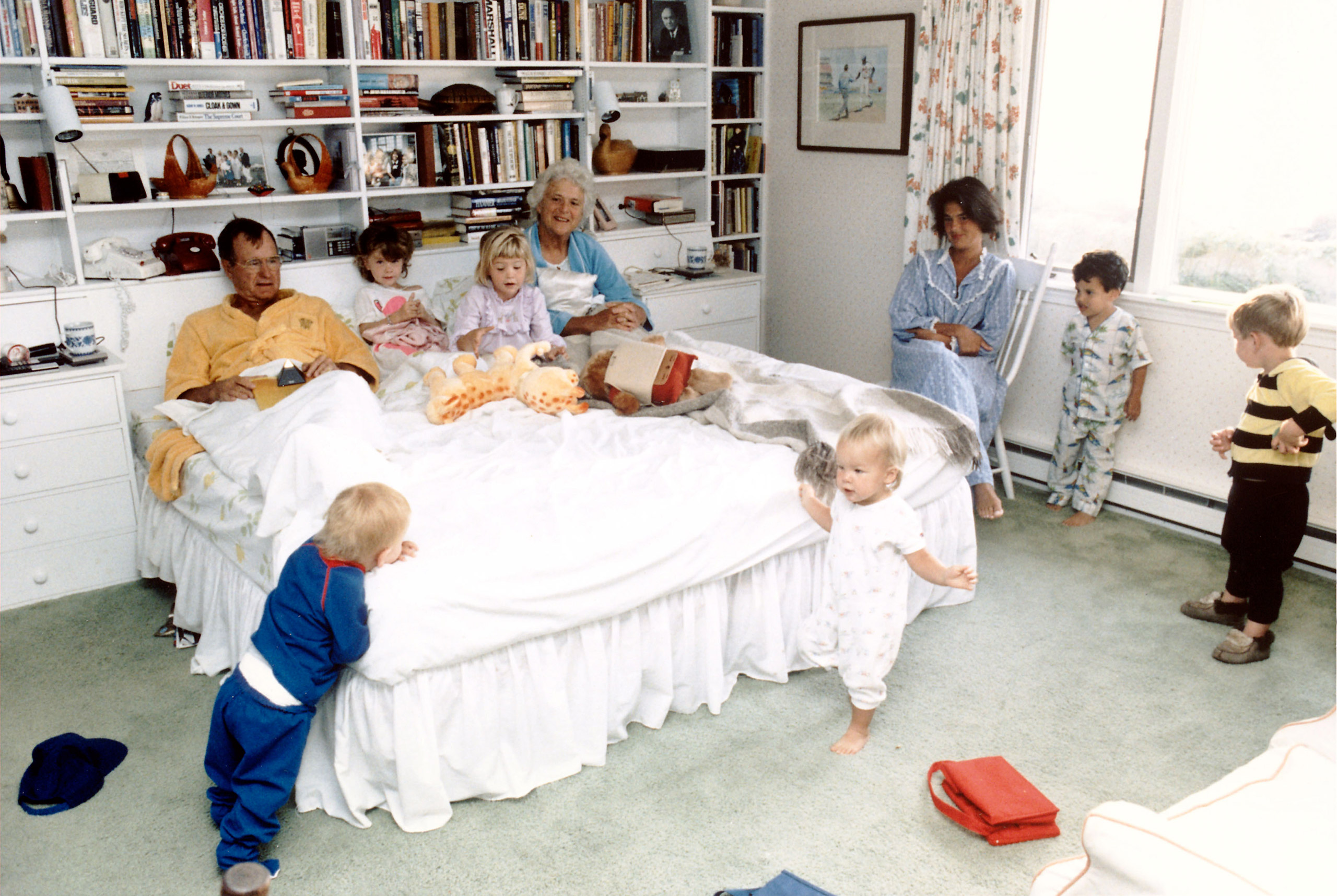 President George H.W. and Barbara Bush with their grandchildren (L-R) Pierce, twins Barbara and Jenna (in bed), Marshall, Jeb. Jr. and Sam LeBlond in the bedroom of their summer home at Walker's Point in Kennebunkport, Maine,  in 1987.