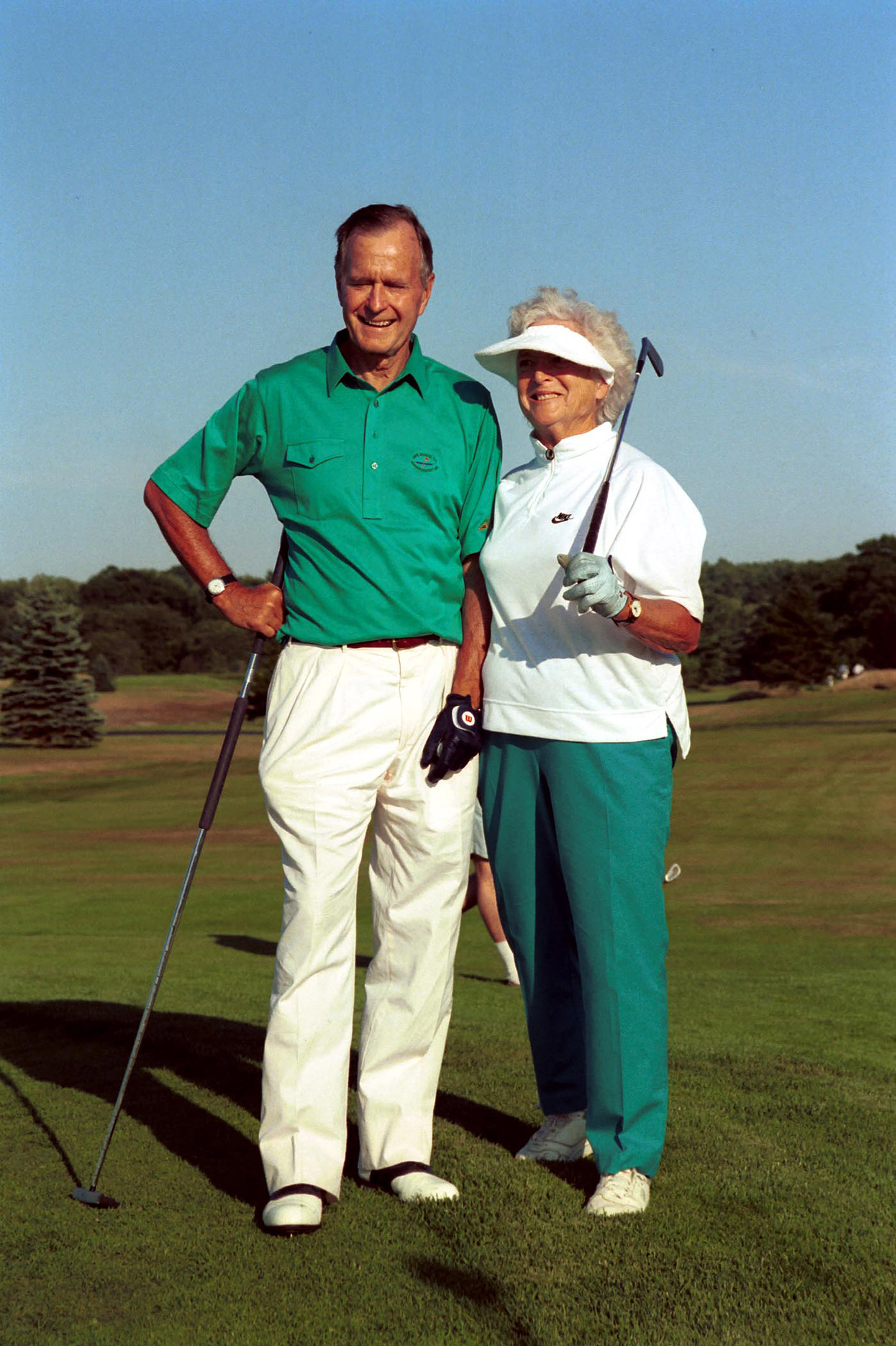 President and Mrs. Bush play golf on Aug. 7, 1991.