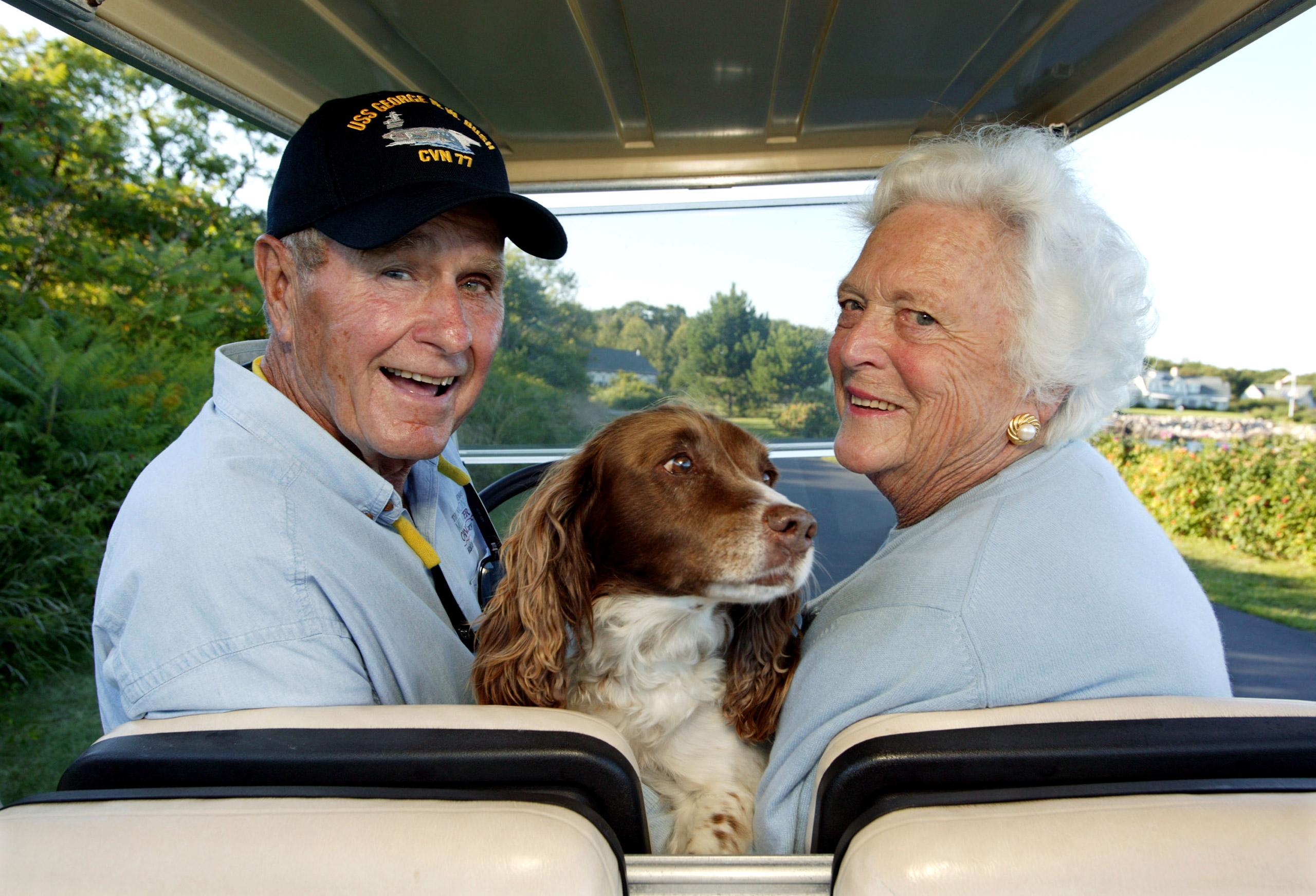 Former President George H.W. Bush and wife, Barbara Bush, cruising around in the back of a golf cart with their dog Millie at their home at Walker's Point in Kennebunkport, ME, on Aug. 25, 2004.
