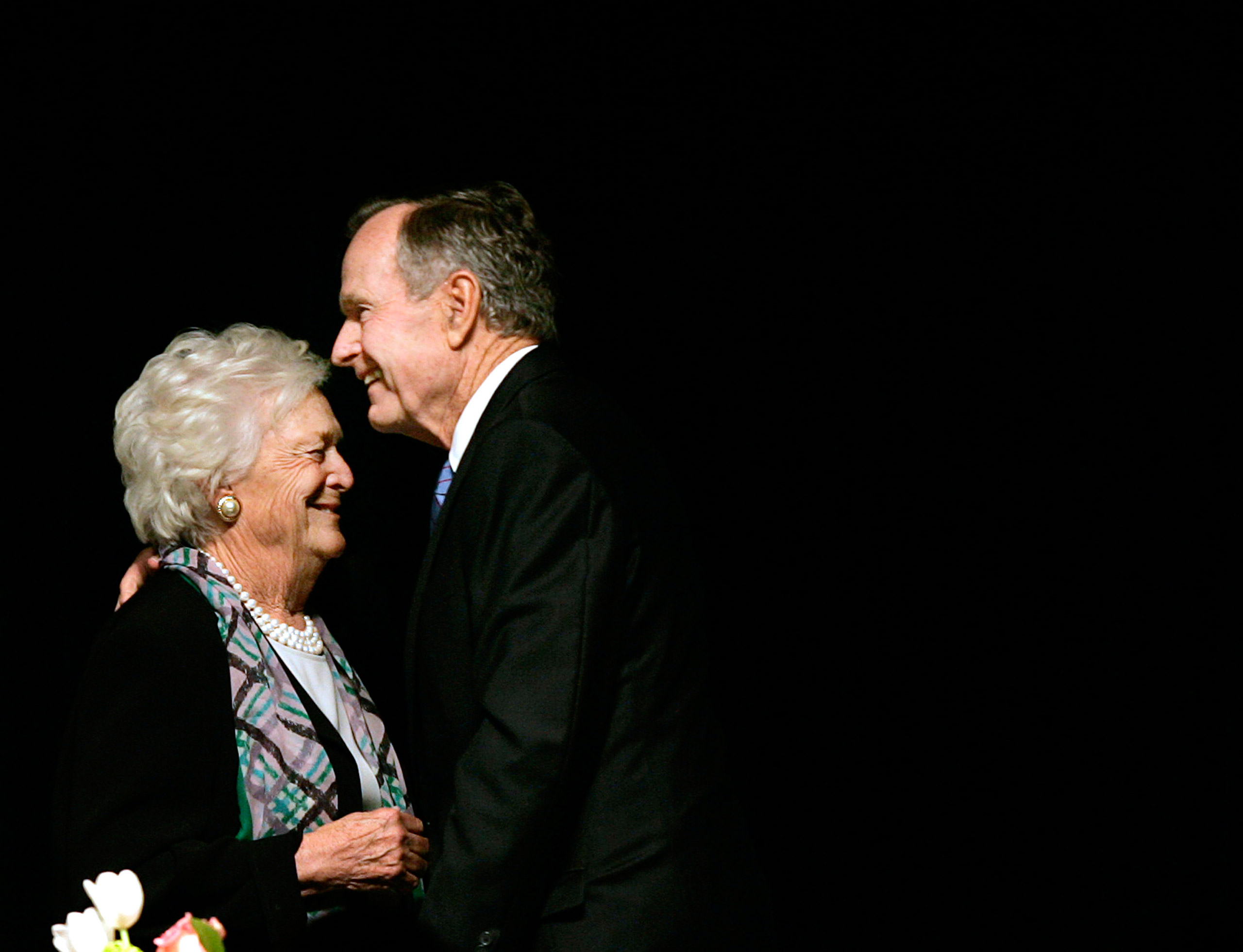 Former President George H.W. Bush, embraces former First Lady Barbara Bush after she introduced the former President at the Genesis Women's Shelter Mother's Day Luncheon in Dallas, Texas, on May 3, 2006.