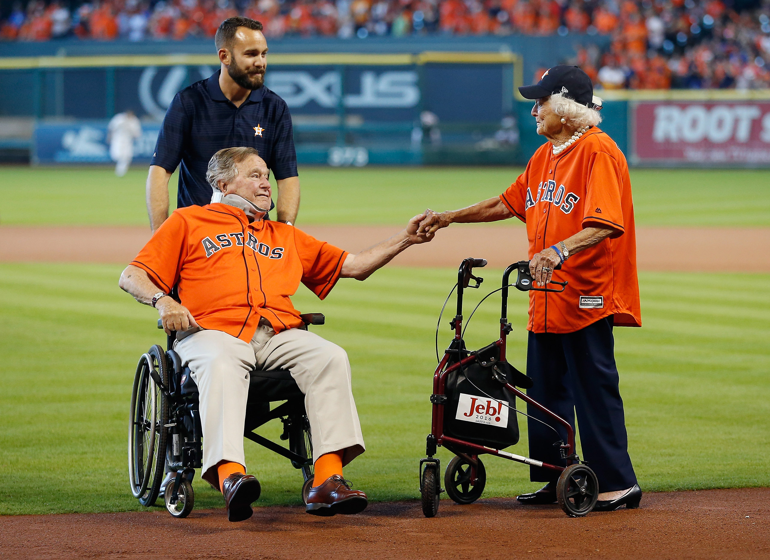 Former President George H.W. Bush and former First Lady Barbara Bush are introduced prior to throwing the ceremonial first pitch to kick off Game 3 of the American League Division Series between the Houston Astros and the Kansas City Royals at Minute Maid Park in Houston, TX on Oct. 11, 2015.