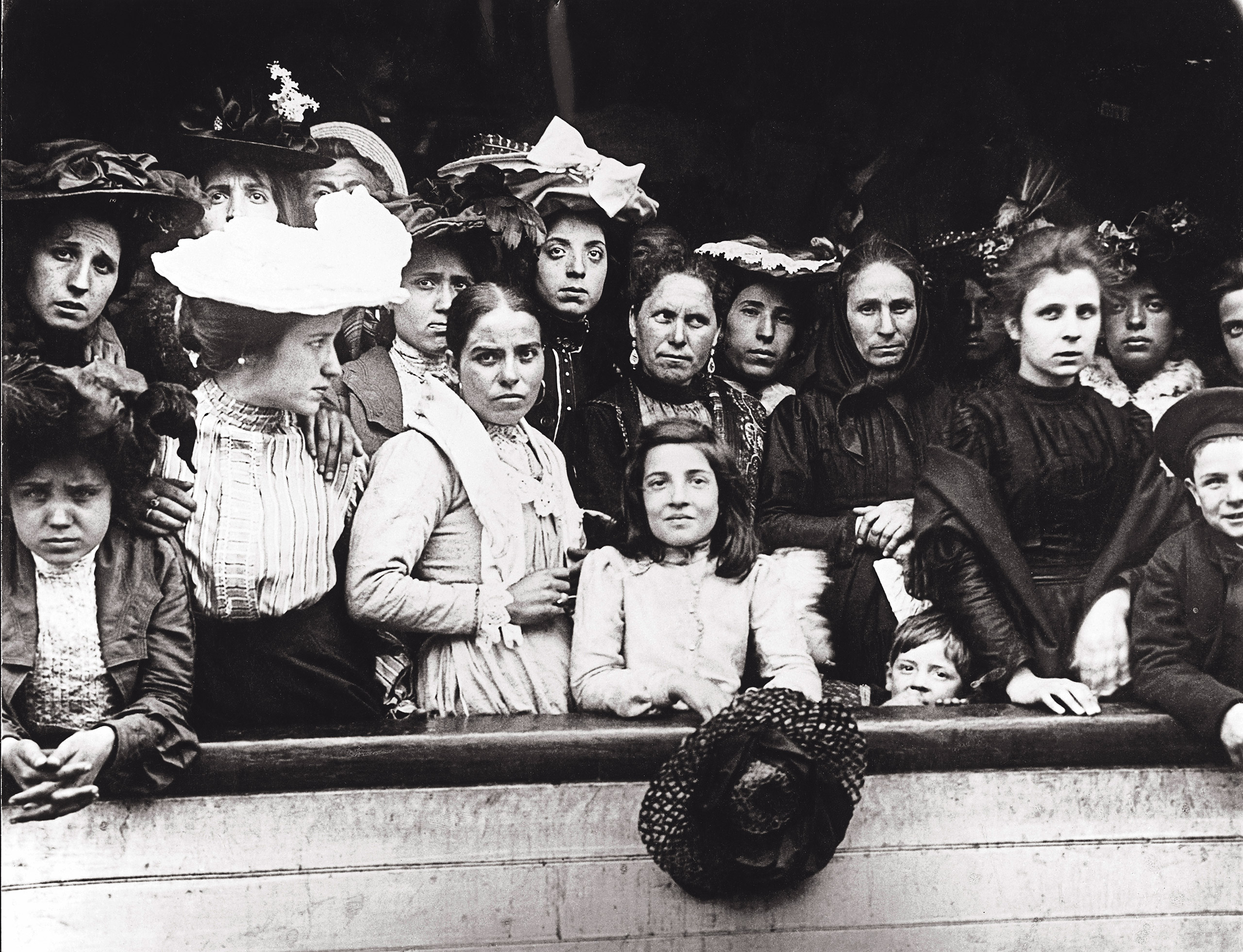 Immigrants on board a ship arriving in New York, circa 1910.