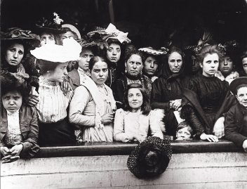 Immigrants on board of a ship arriving in New York, circa 1910.