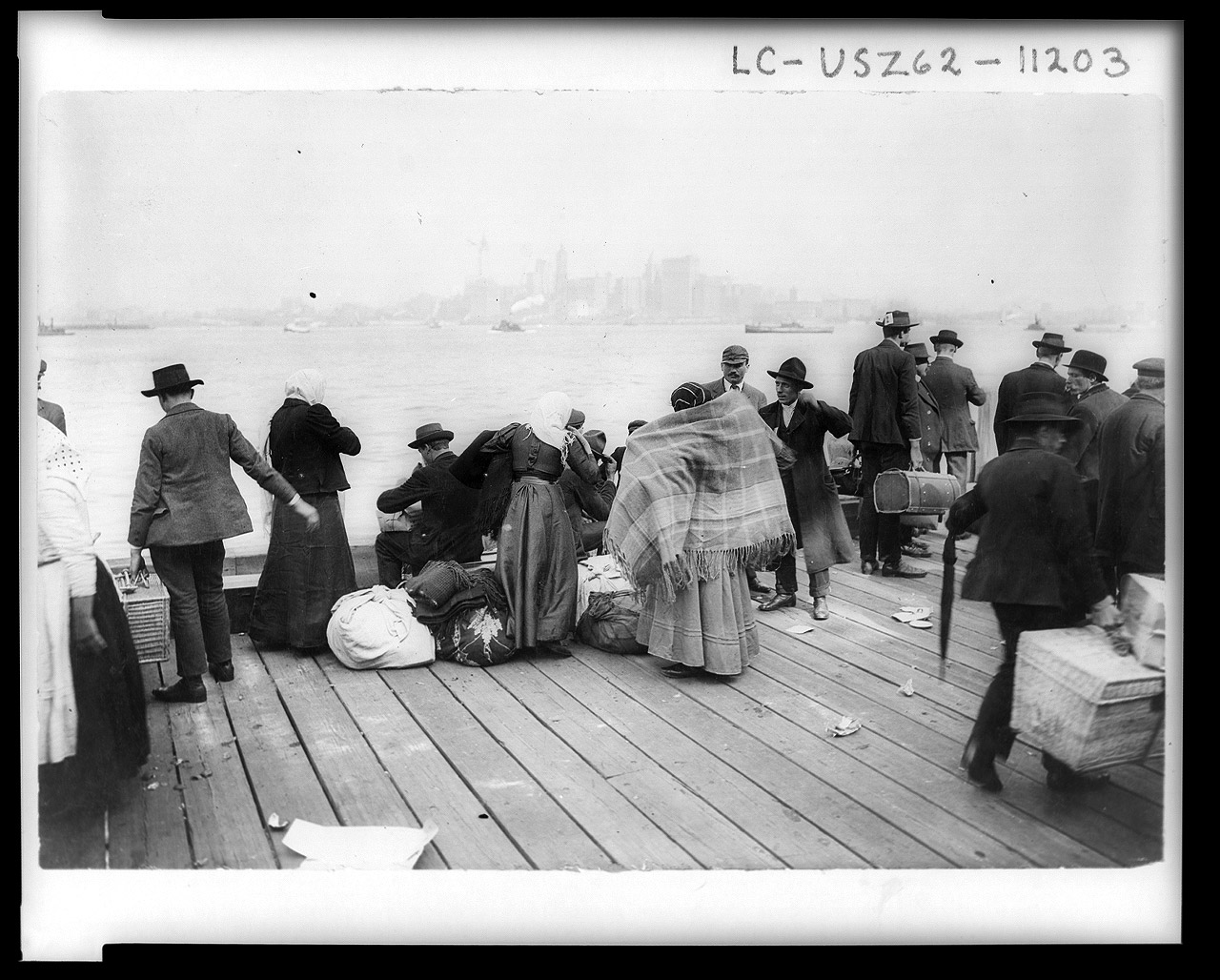 Immigrants waiting to be transferred, Ellis Island, Oct. 30, 1912