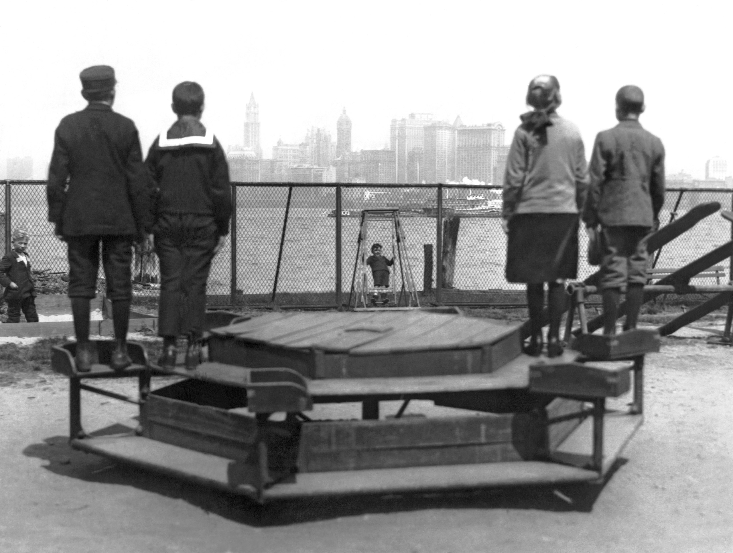 Immigrants representing four countries, Poland, Norway, Germany and Russia, looking from Ellis Island towards New York City, circa 1913.