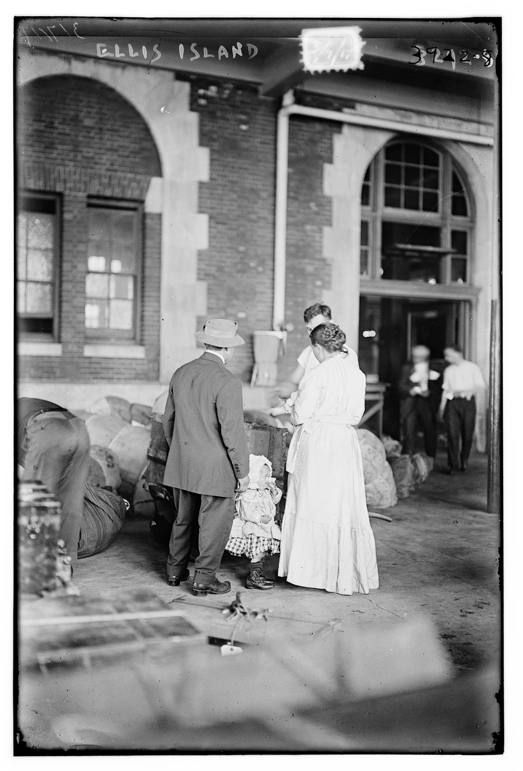 Immigrant family at Ellis Island. New York City. March 1917.