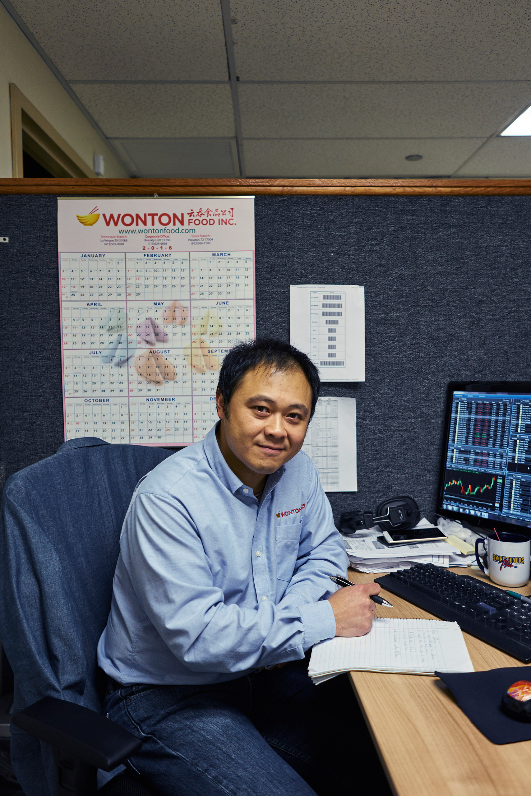 The new Chief Fortune Writer, James Wong, at his desk working. Wonton Food Inc. Brooklyn, New York. Jan. 18th, 2017