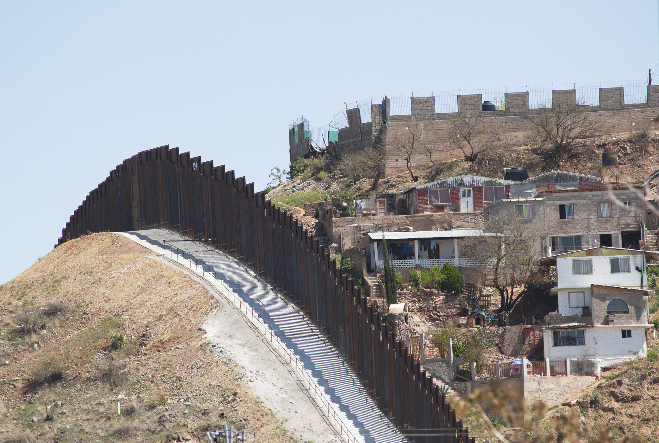 The steel beam border fence overlooks Nogales, Mexico.