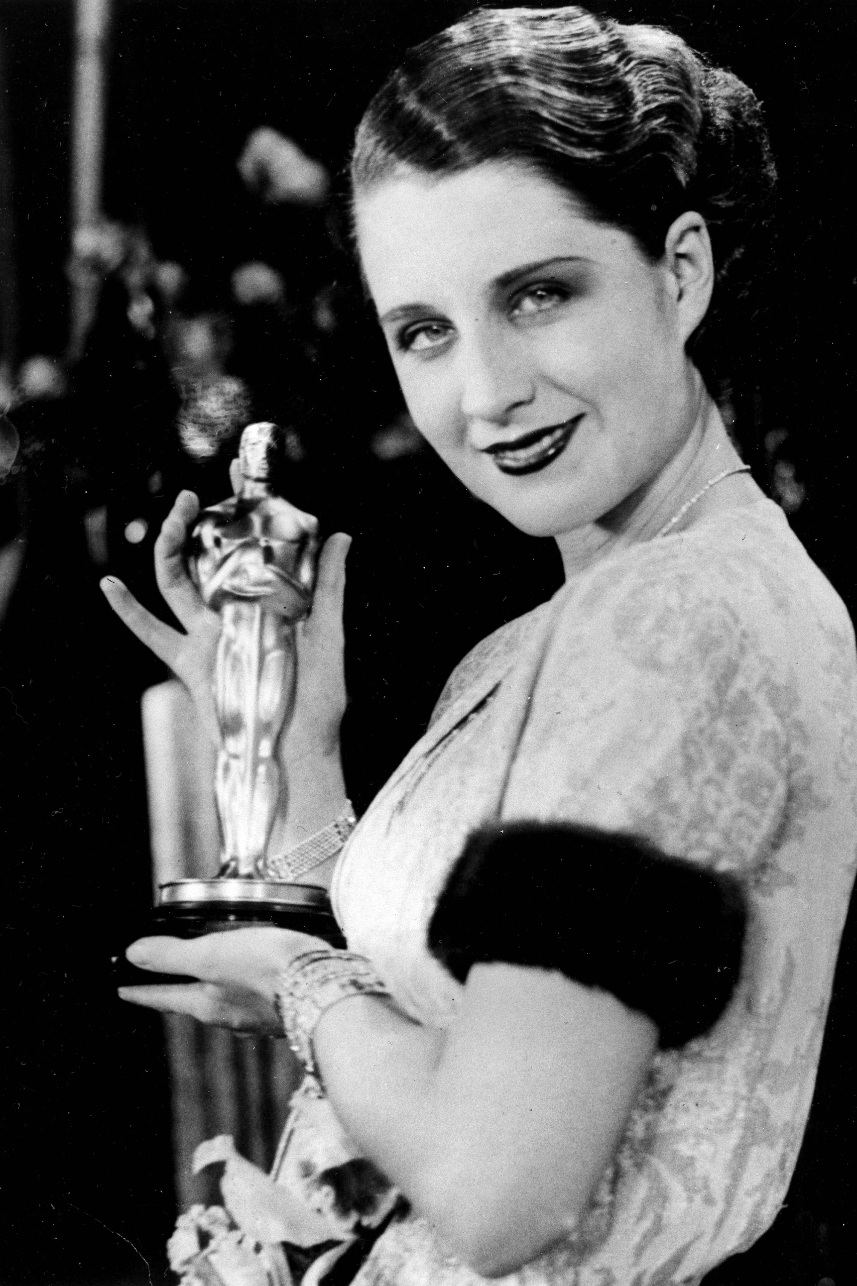 Norma Shearer poses with her Oscar at the Academy Awards banquet in 1930.