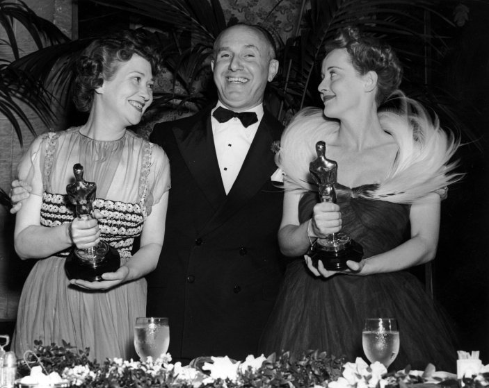 Jack Warner with Fay Bainter and Bette Davis who hold their Oscars at the Academy Awards, 1939.