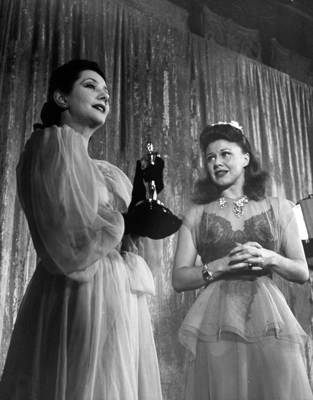 Ginger Rogers receiving an Oscar at Academy Awards presentation, 1941.