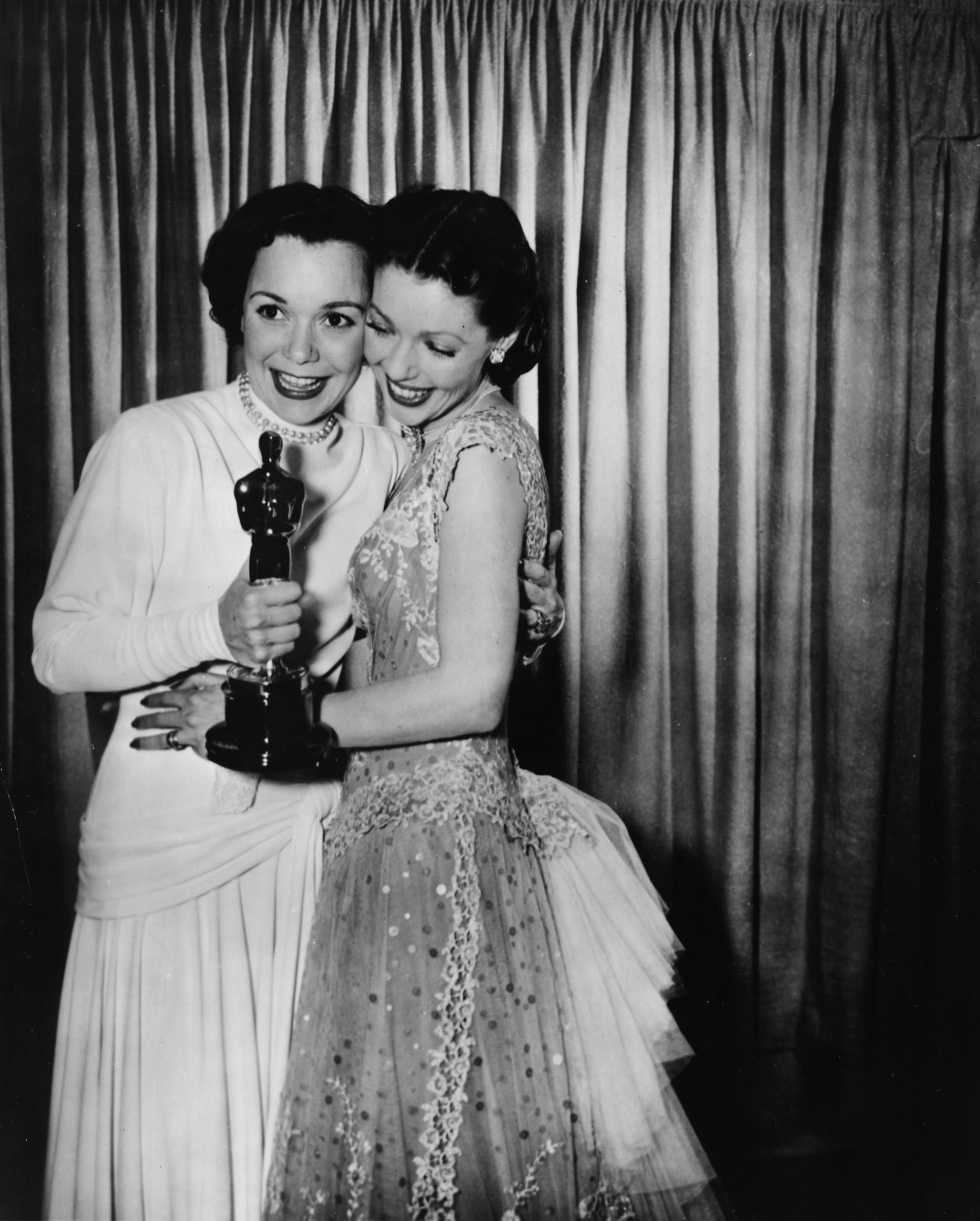 Loretta Young congratulating Jane Wyman at the Academy Awards, 1949.
