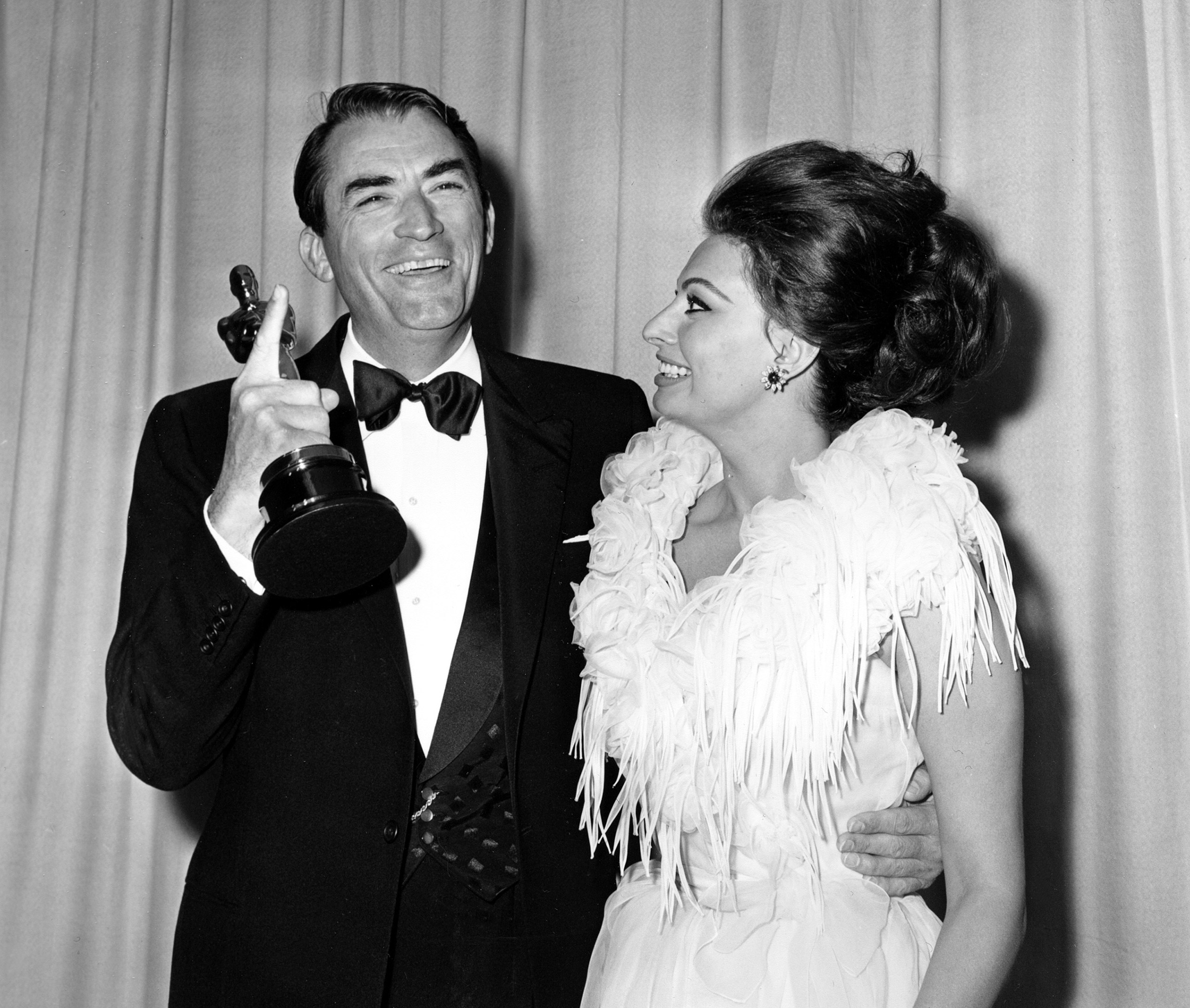 Gregory Peck with Sophia Loren at the Academy Awards, 1963.
