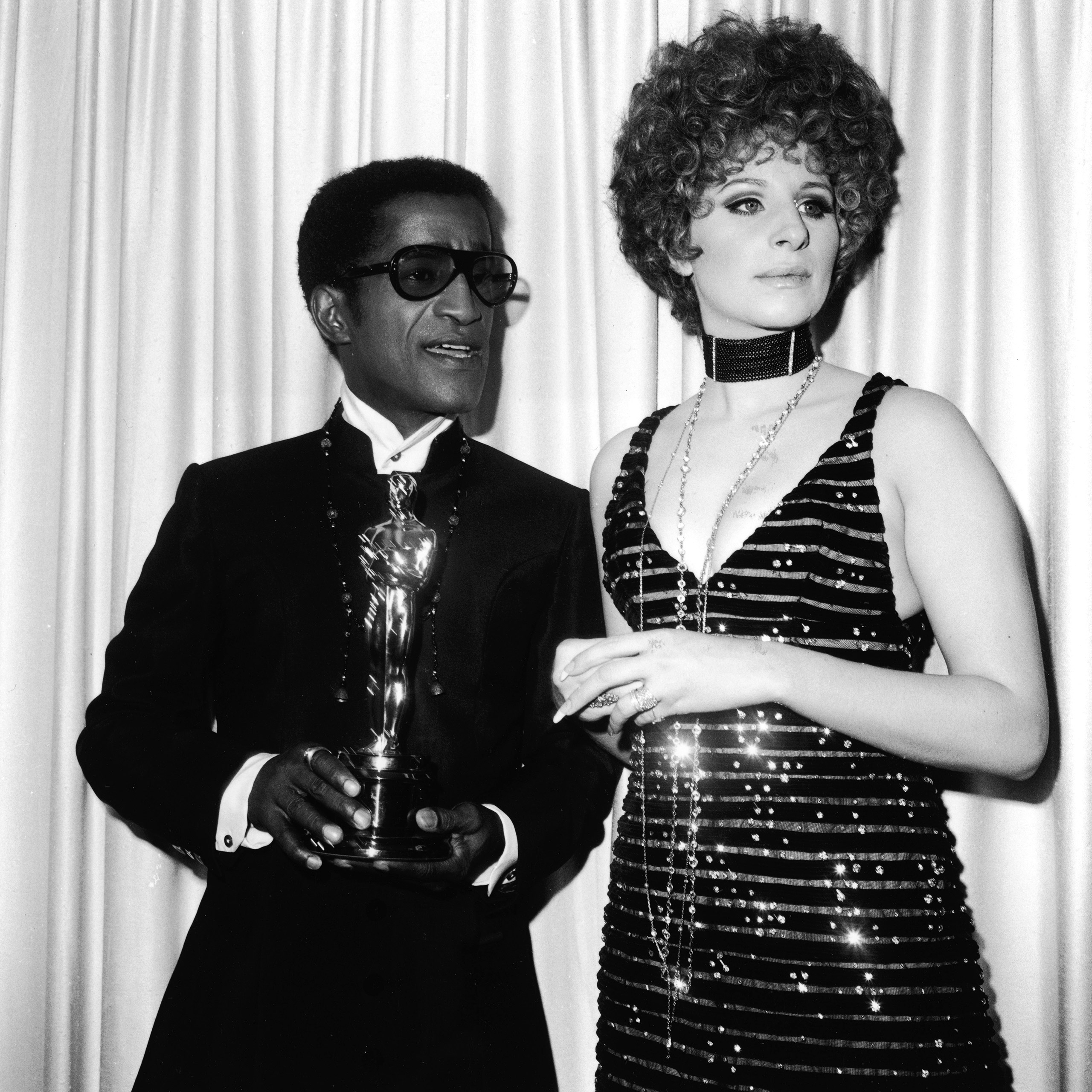 Sammy Davis Jr. with  Barbra Streisand, holding the Oscar for Best Song, at the Academy Awards, 1968.