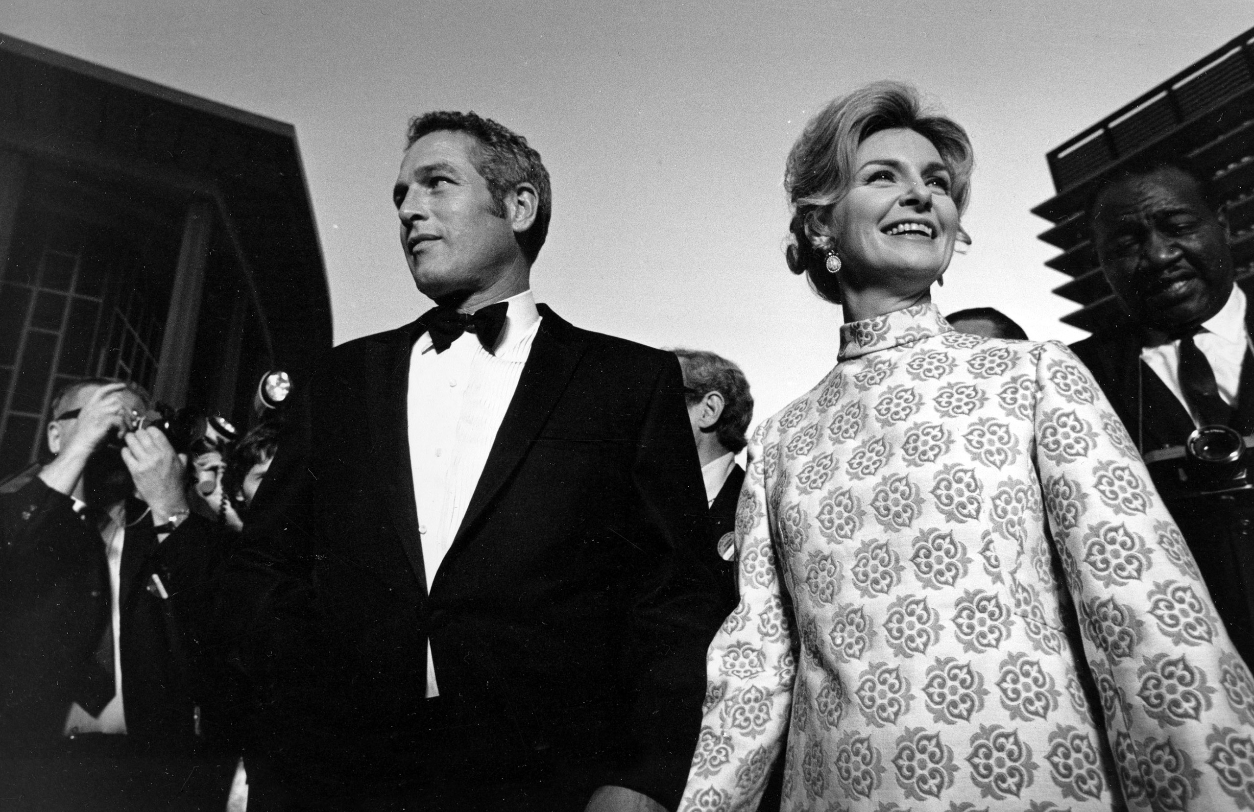 Joanne Woodward arrives with her husband, Paul Newman, at the Academy Awards, 1969.