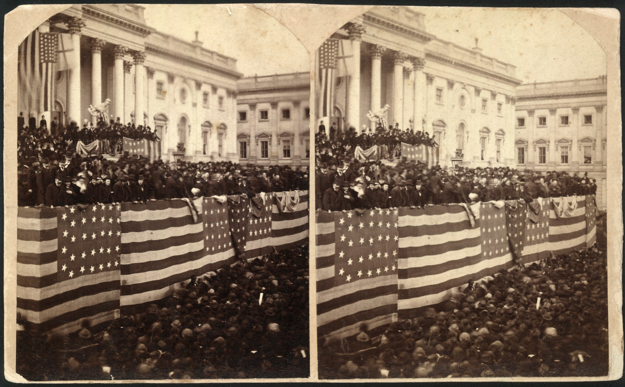 Chief Justice Morrison R. Waite administering the oath of office to Rutherford B. Hayes on a flag-draped inaugural stand on the east portico of the U.S. Capitol, 1877.