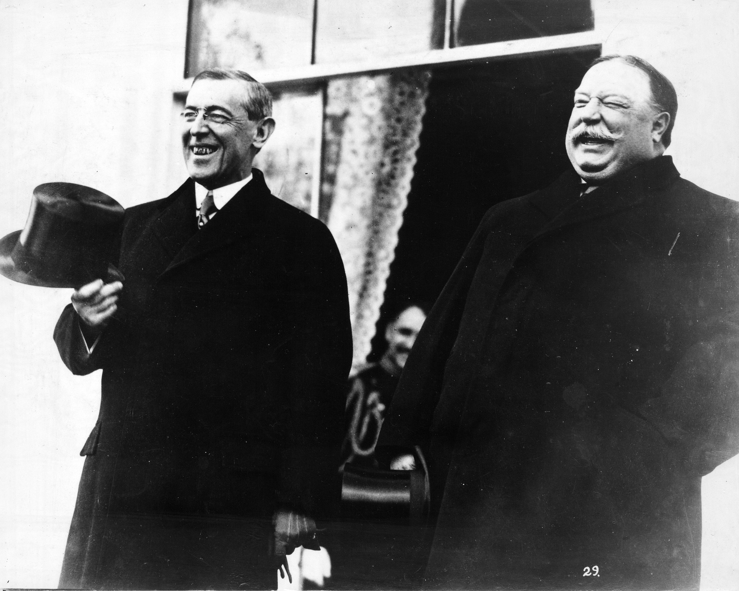 President-elect Woodrow Wilson and President Taft, standing side by side, laughing, at the White House, prior to Wilson's inauguration ceremonies, March 4, 1913.