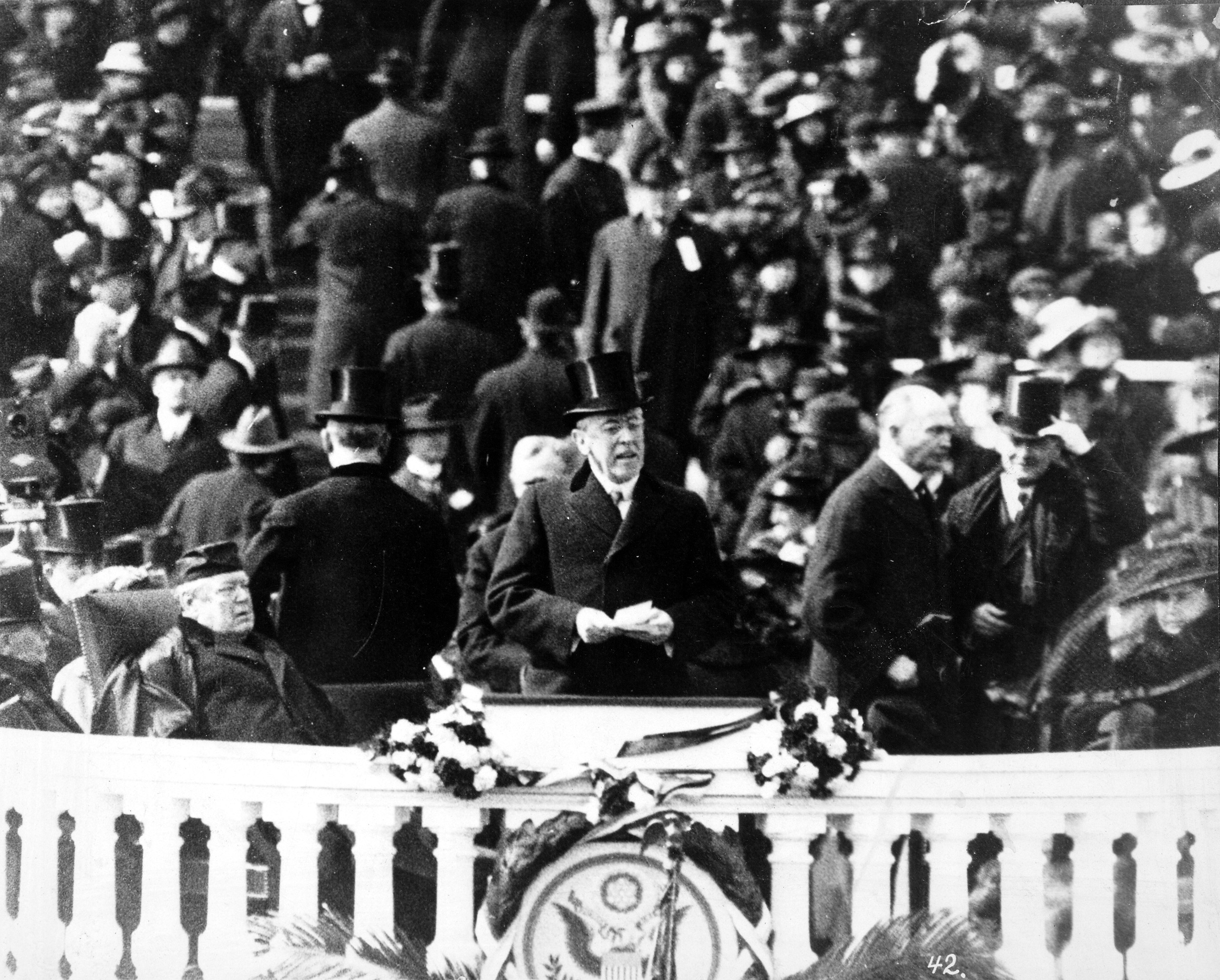 President Woodrow Wilson, with top hat and speech in hand, delivering his inaugural address, March 5, 1917.