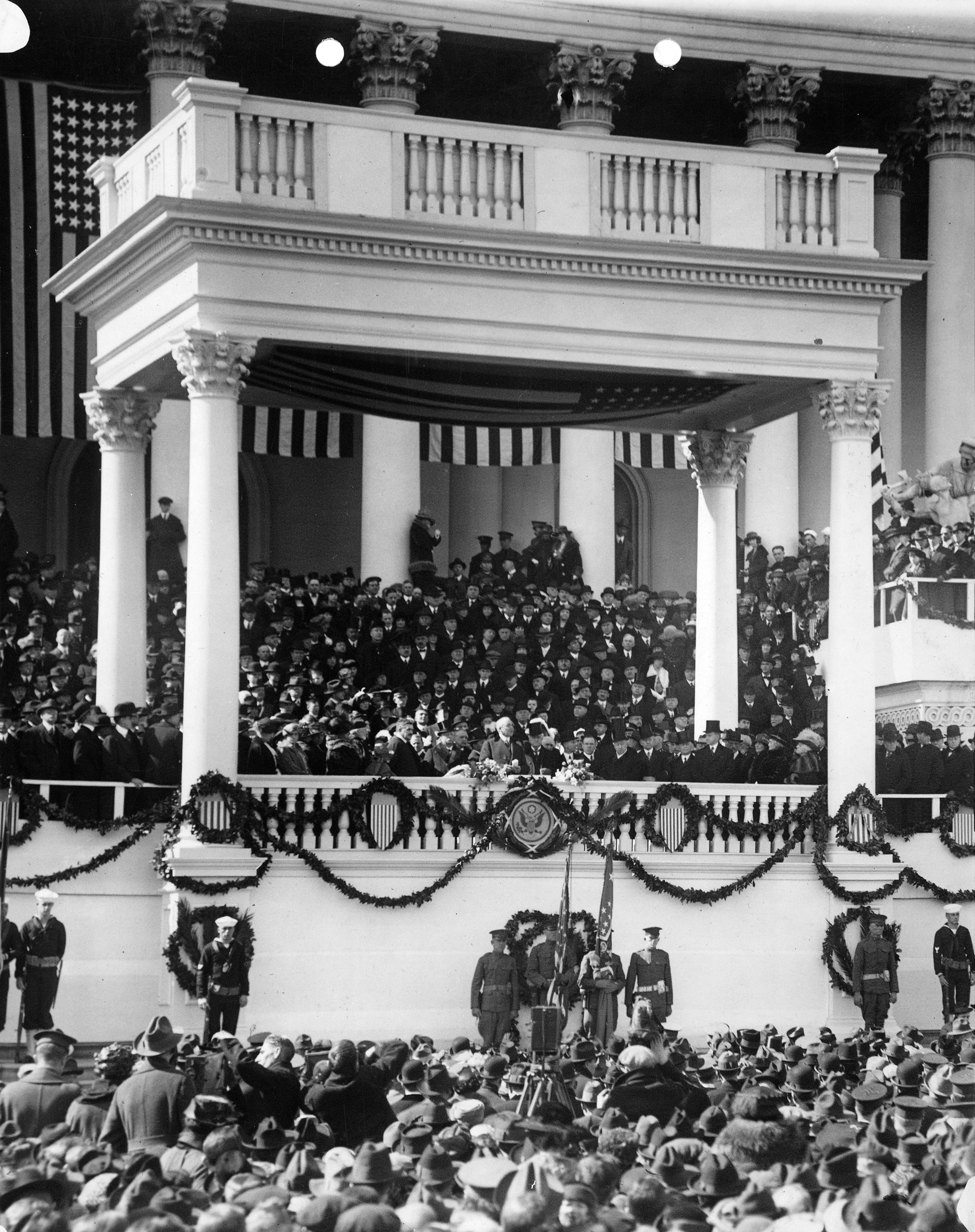 Warren G. Harding delivering his inaugural address on east portico of U.S. Capitol, March 4, 1921.
