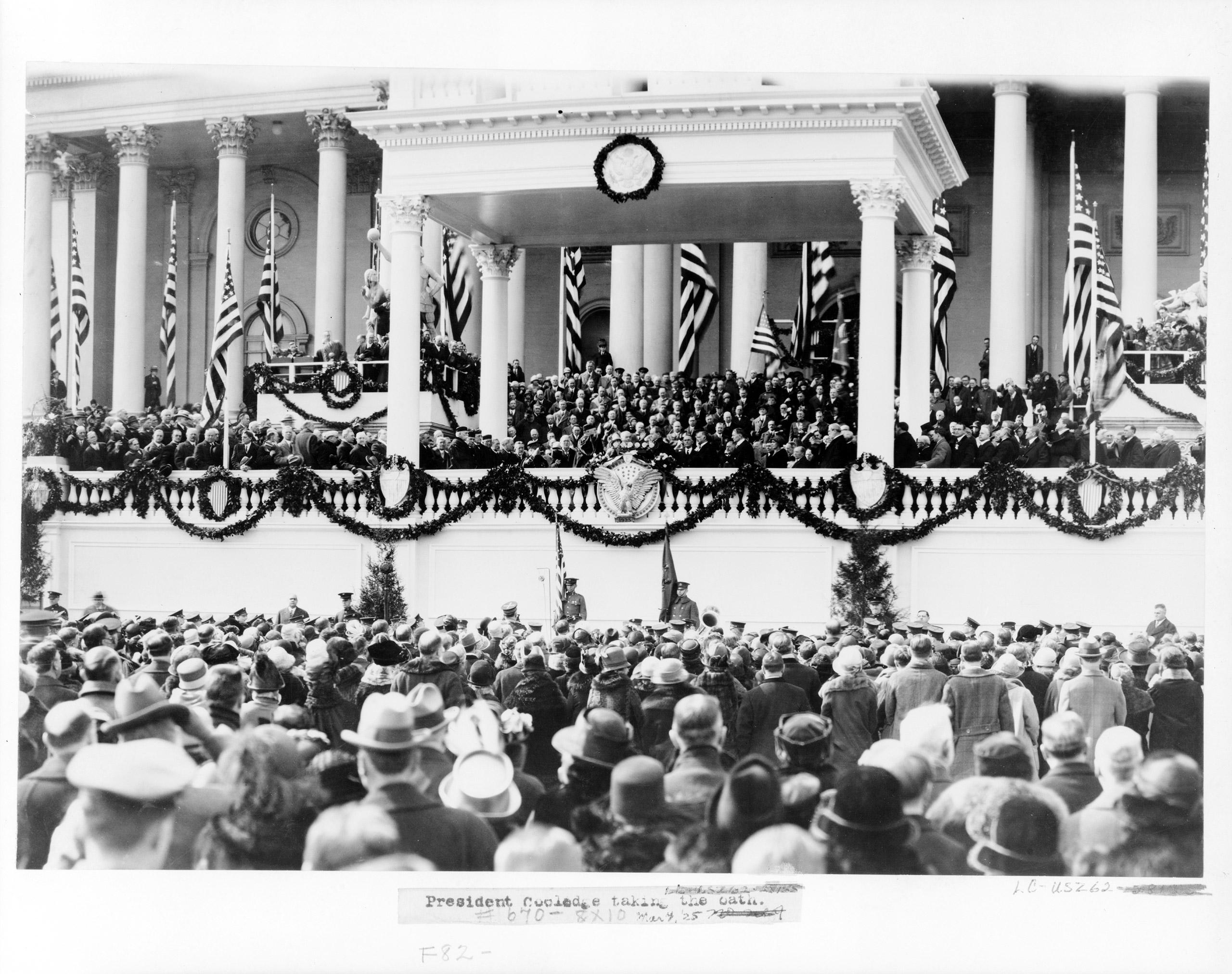 Chief Justice William H. Taft administering the oath of office to Calvin Coolidge on the east portico of the U.S. Capitol, March 4, 1925.