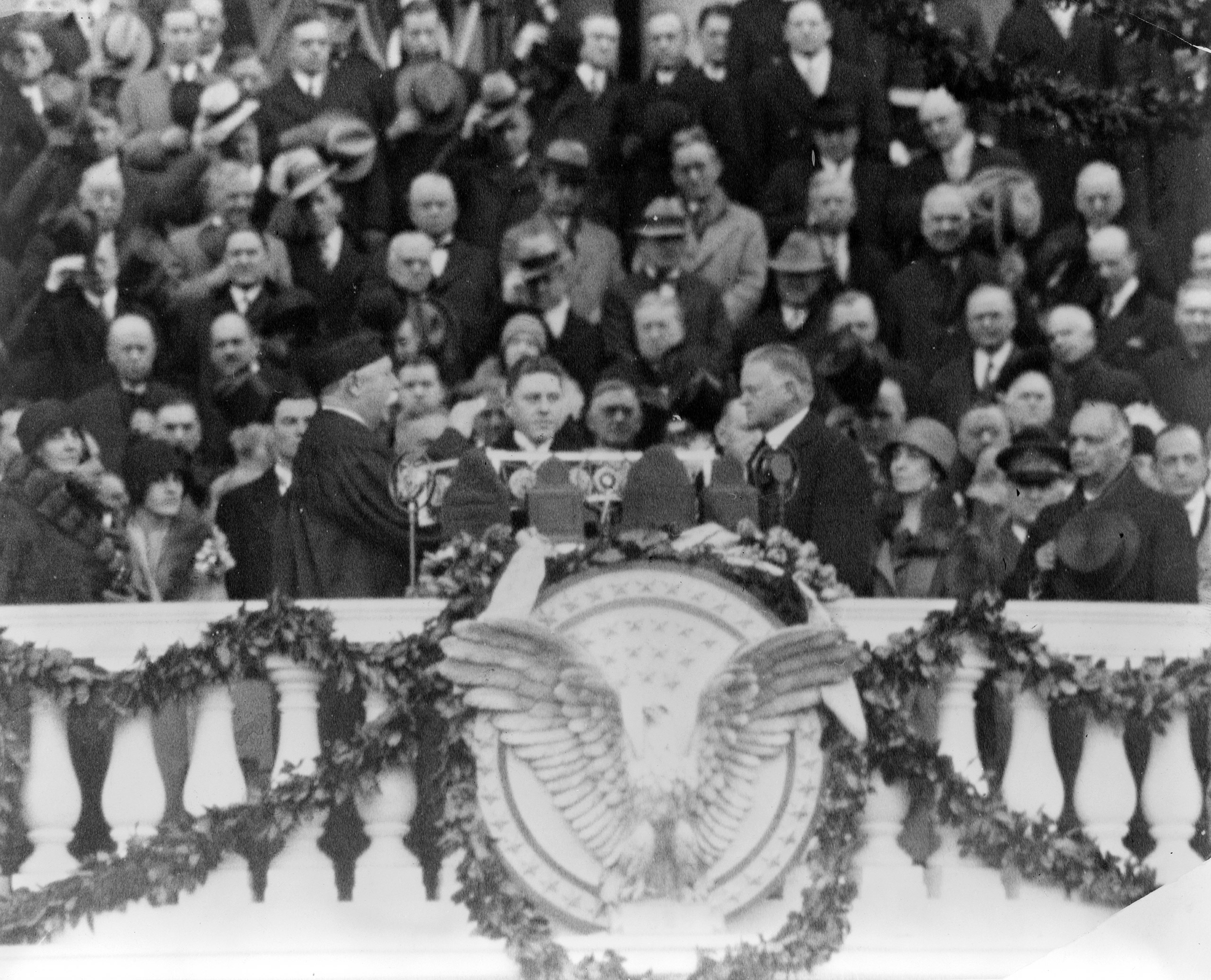 Chief Justice William H. Taft administering the oath of office to Herbert Hoover on the east portico of the U.S. Capitol, March 4, 1929.