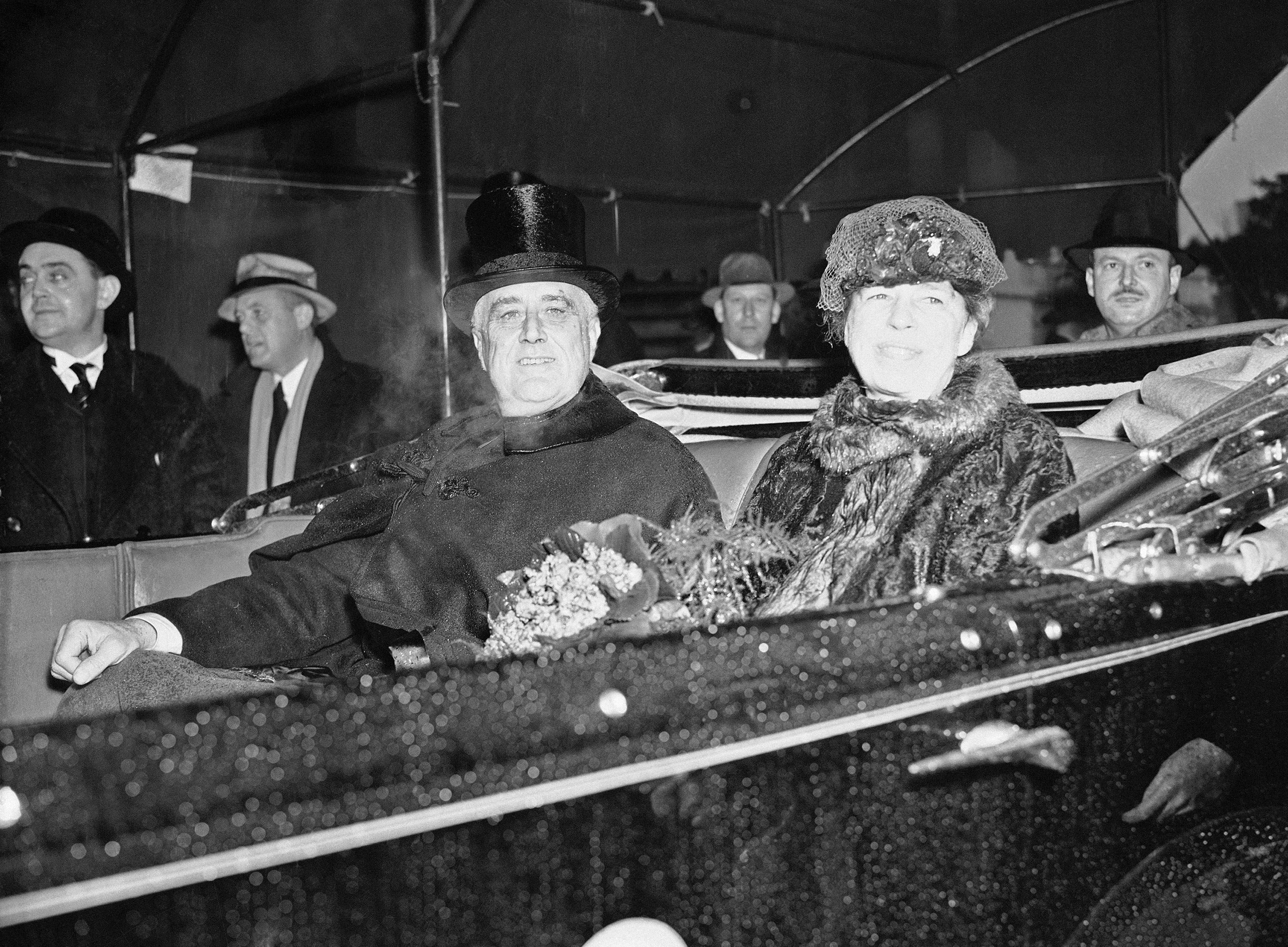 President Franklin D. Roosevelt and first lady Eleanor Roosevelt are seen up Pennsylvania Avenue during the inaugural parade in Washington, Jan. 4, 1937.