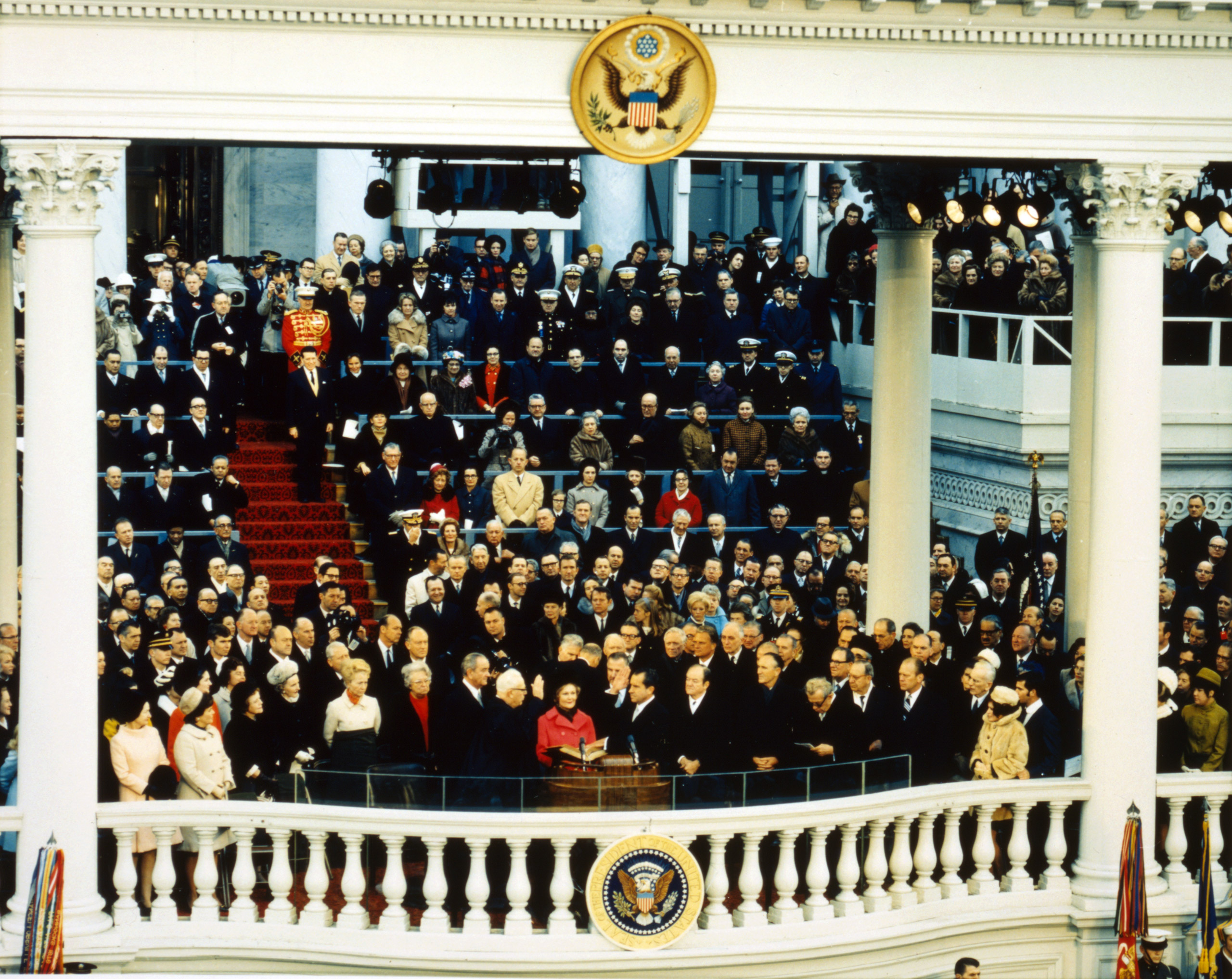 Chief Justice Earl Warren administering the oath of office to Richard M. Nixon on the east portico of the U.S. Capitol, January 20, 1969.