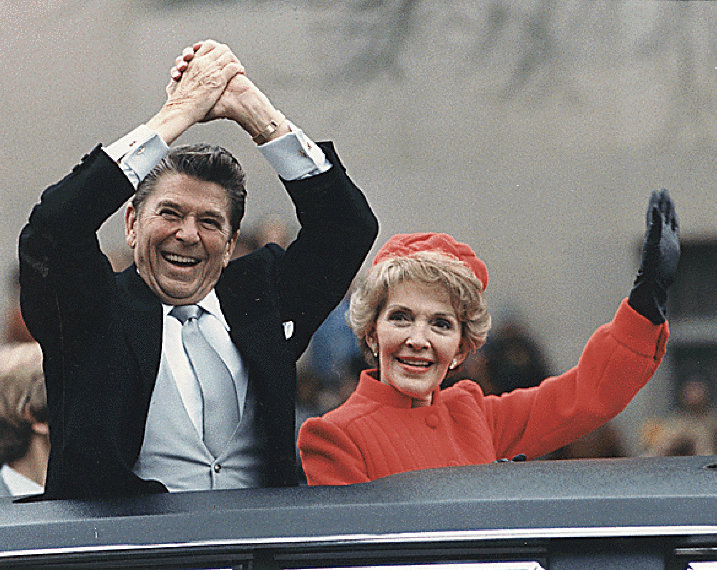 President Ronald Reagan and First Lady Nancy Reagan wave to well-wishers during the Inaugural Parade in Washington, DC on January 20, 1981.