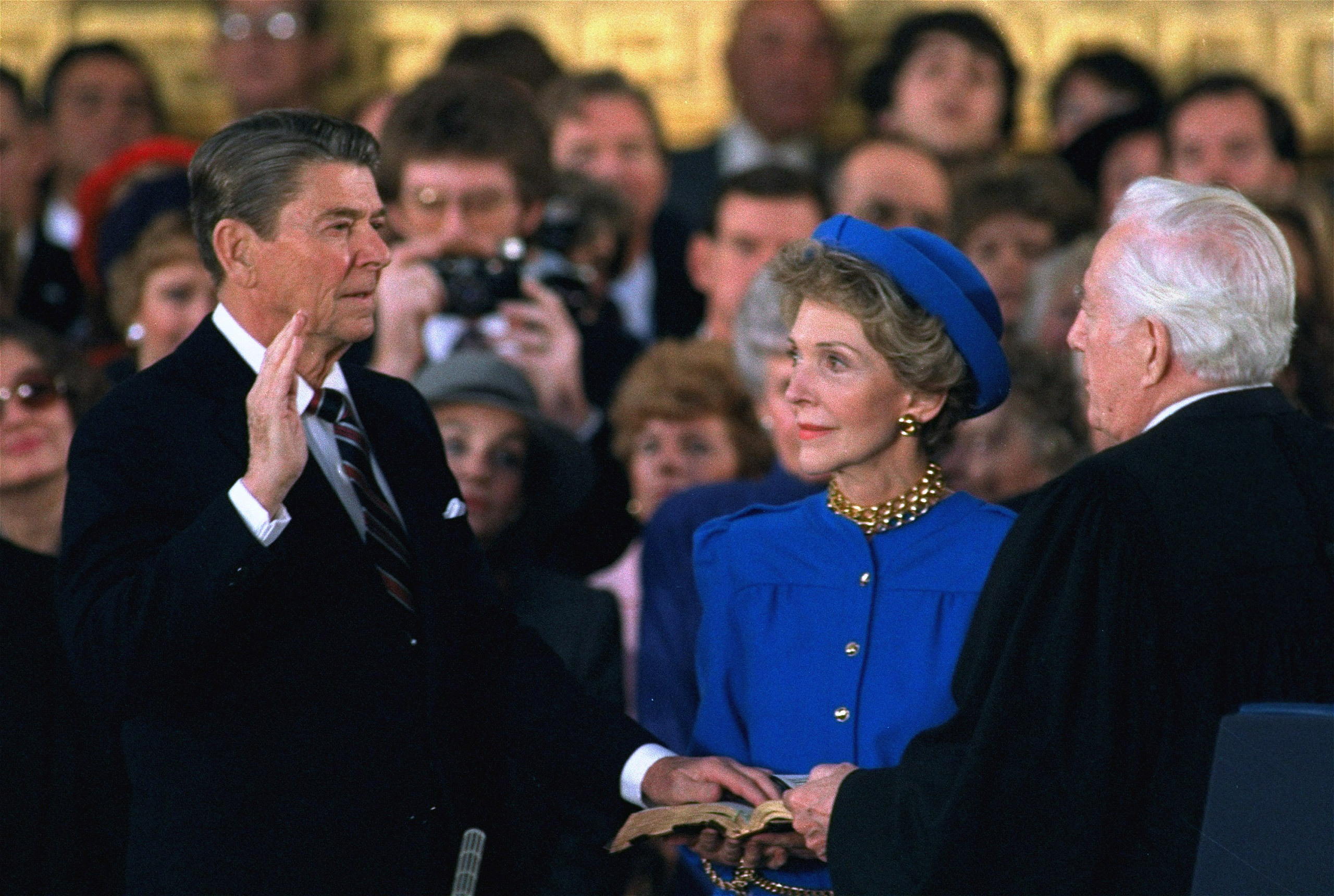 First Lady Nancy Reagan watches as President Ronald Reagan is sworn in during ceremonies in the Rotunda beneath the Capitol Dome in Washington, Jan. 21, 1985.