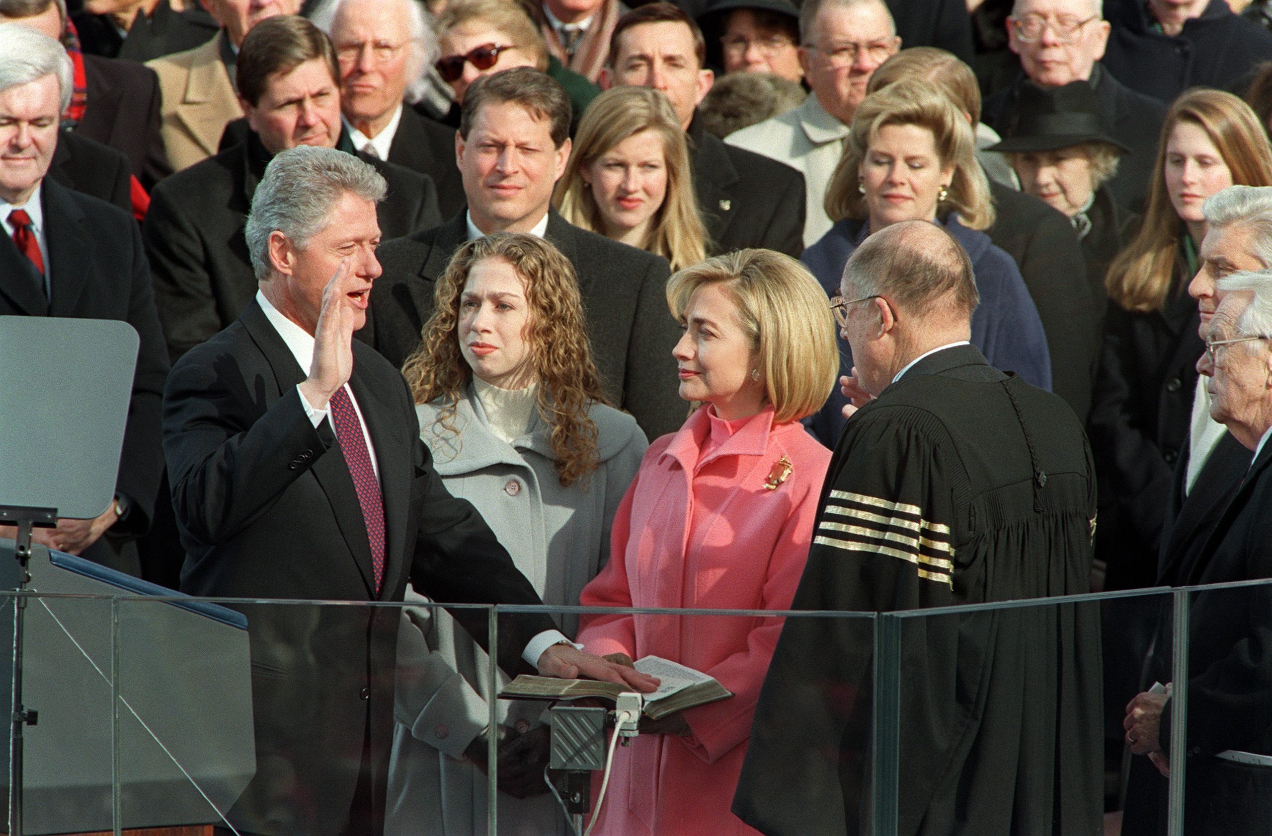 President Bill Clinton is sworn in Jan. 20, 1997 on Capitol Hill in Washington, D.C., for his second term as president of the United States by US Supreme Court Chief Justice William Rehnquist as First Lady Hillary Rodham Clinton and daughter Chelsea look on.