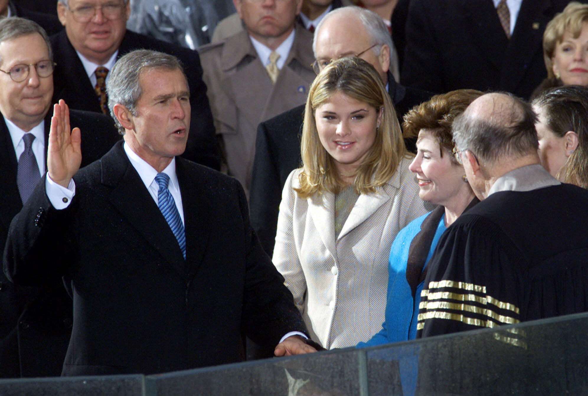 George W. Bush takes the oath of office from Chief Justice William Rehnquist to become the 43rd president Saturday, Jan. 20, 2001, in Washington.