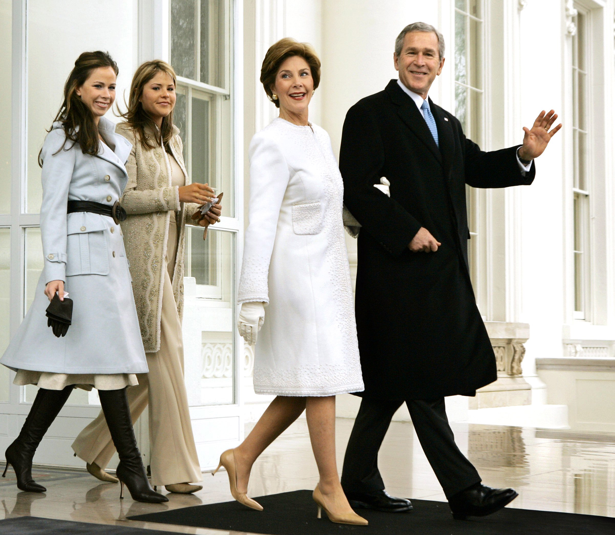 President George W. Bush, first lady Laura Bush and daughters Barbara and Jenna depart the North Portico of the White House for the limousine ride to the Capitol where he will take the Oath of Office and begin his second term, in Washington, Thursday, Jan. 20, 2005.