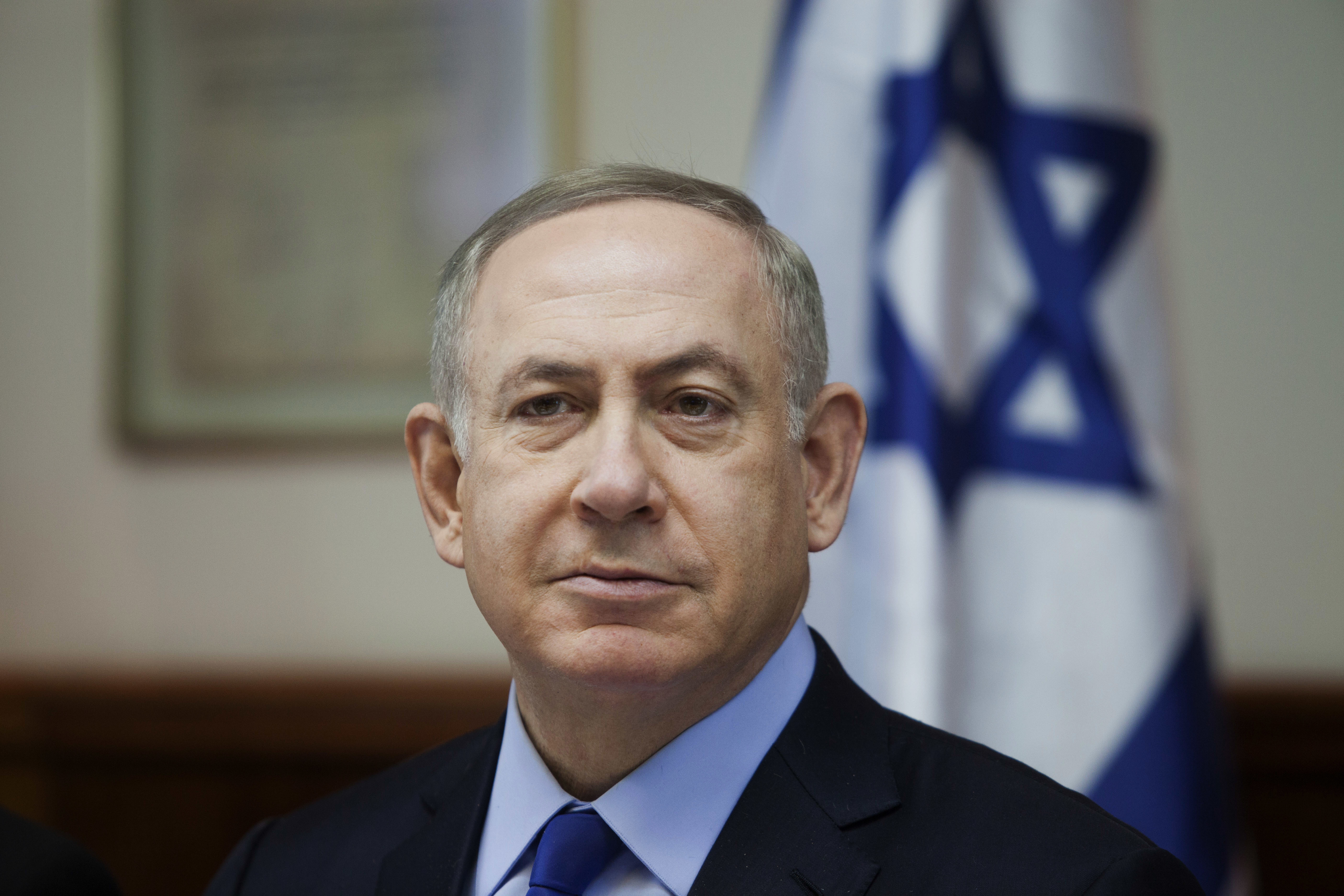 FILE -- In this Sunday, Dec. 25, 2016 file photo, Israeli Prime Minister Benjamin Netanyahu attends a weekly cabinet meeting in Jerusalem. Israel is stepping up its attacks on the Obama administration, saying it has proof from Arab sources that the U.S. actively helped craft a U.N. resolution that declared Israeli settlements illegal. A spokesman for Prime Minister Benjamin Netanyahu says Israel has  ironclad information  that the White House helped draft the language of the resolution. Citing Arab sources, he says the White House  pushed hard  for its passage. (Dan Balilty/Pool photo via AP, File)