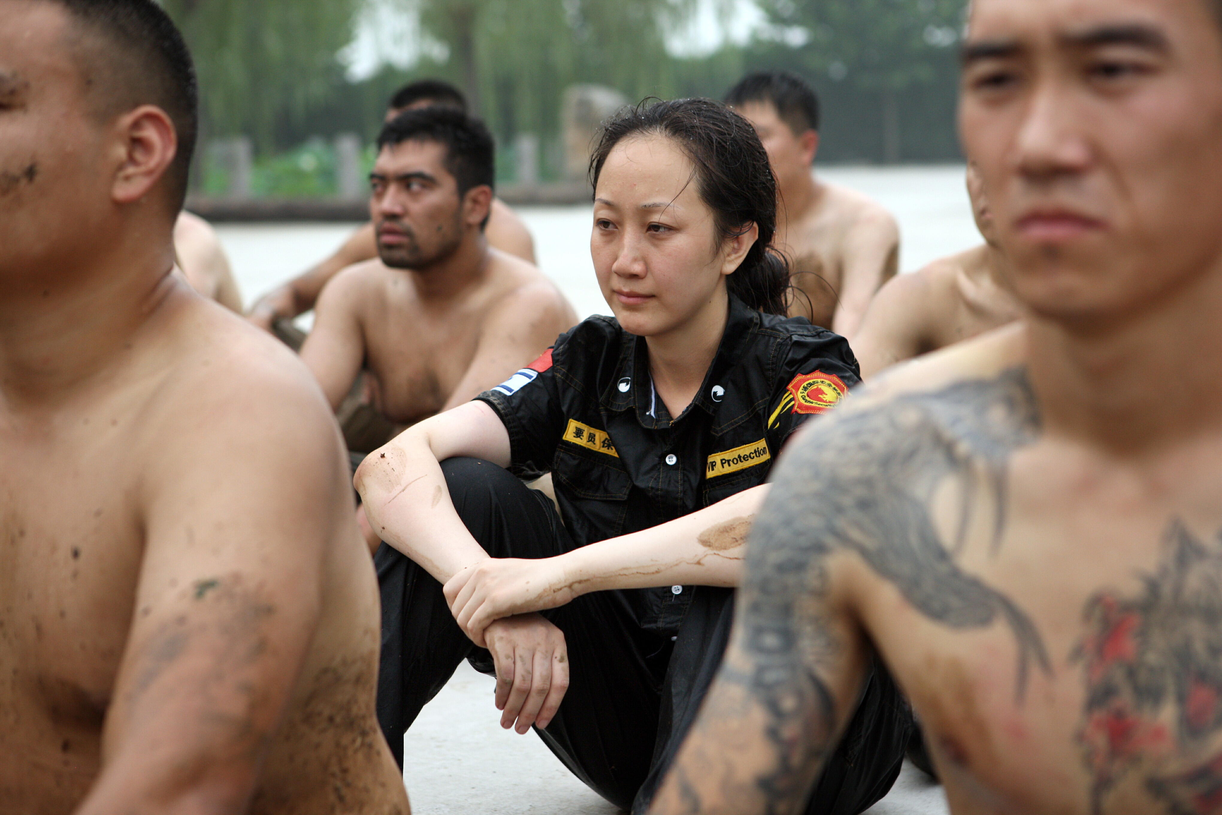 Female and male trainees during a bodyguard-training program at the boot camp of Genghis Security Academy in Beijing on Aug. 21, 2013