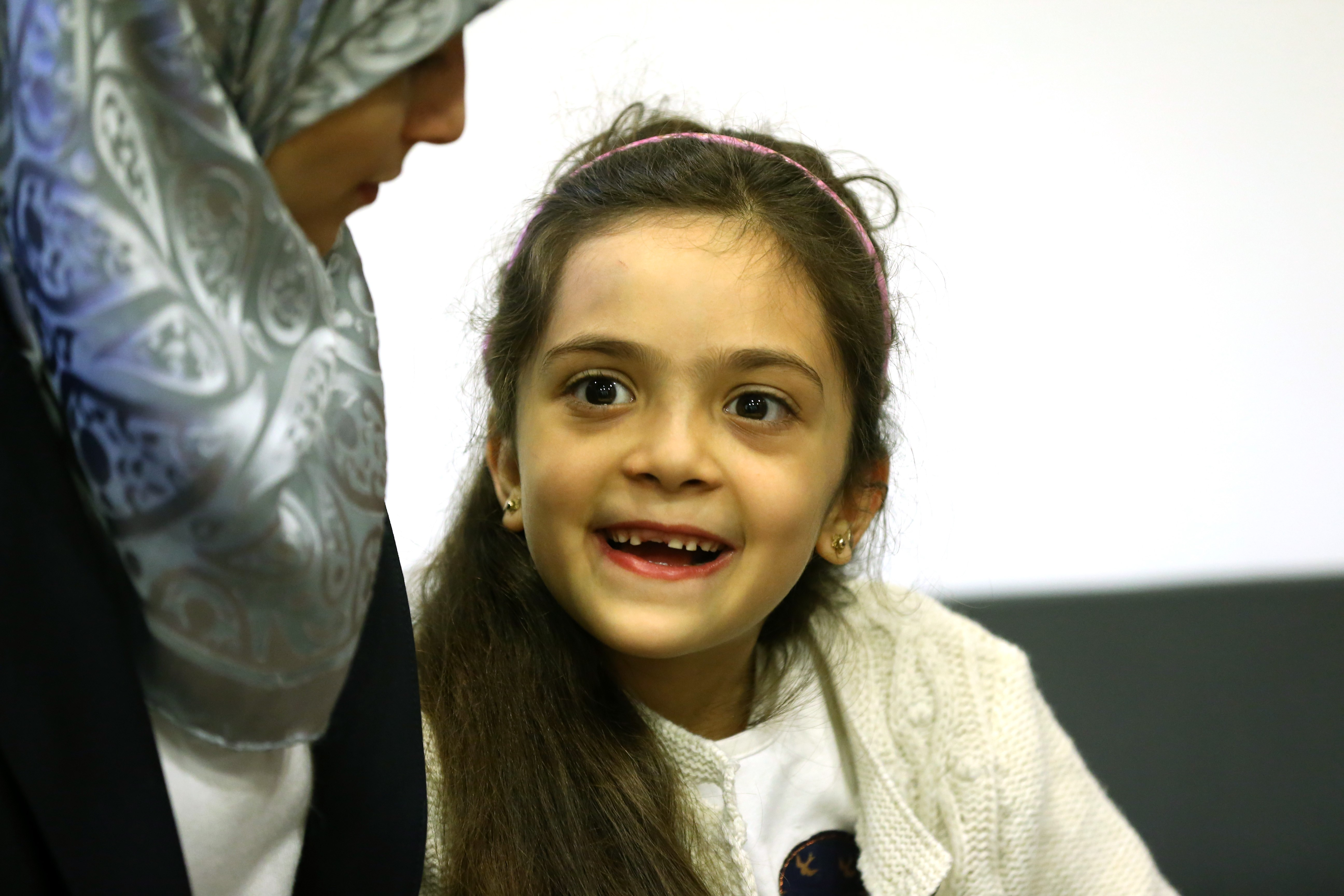 Syrian Bana Alabed (R), a seven-year-old girl who tweeted about the attacks in Aleppo, speaks to media with her family after she met with Turkish President Recep Tayyip Erdogan in Ankara, Turkey on December 21, 2016.