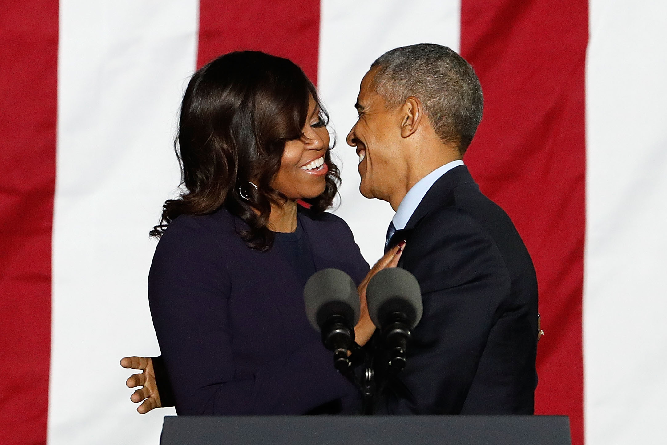 Michelle Obama and Barack Obama embrace during  The Night Before  campaign rally at Independence Hall on November 7, 2016 in Philadelphia, Pennsylvania.