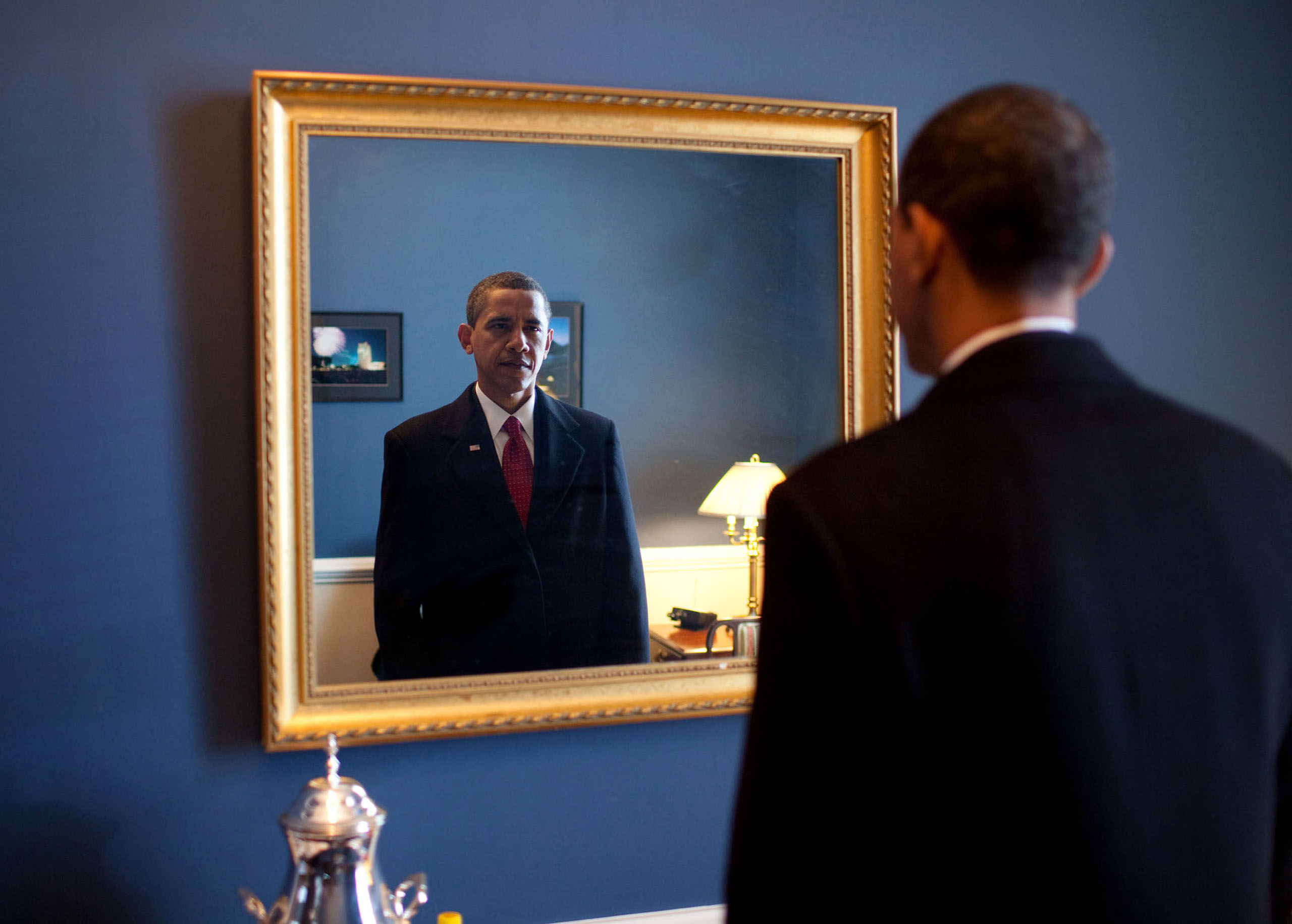 """""""President-elect Barack Obama was about to walk out to take the oath of office. Backstage at the U.S. Capitol, he took one last look at his appearance in the mirror,""""Jan. 20, 2009."""