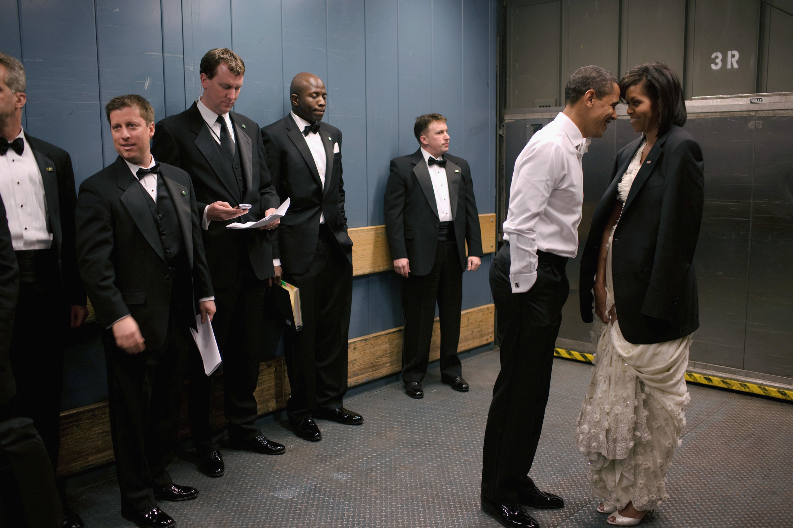 """""""We were on a freight elevator headed to one of the Inaugural Balls. It was quite chilly, so the President removed his tuxedo jacket and put it over the shoulders of his wife. Then they had a semi-private moment as staff member and Secret Service agents tried not to look,""""Jan. 20, 2009."""