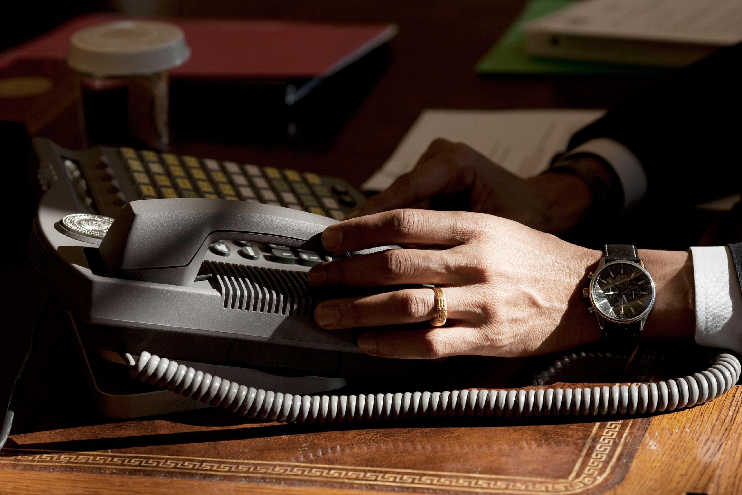 The President was about to answer the phone when I noticed how the sun light streaming through the window illuminated his hand,  Jan. 23, 2009.