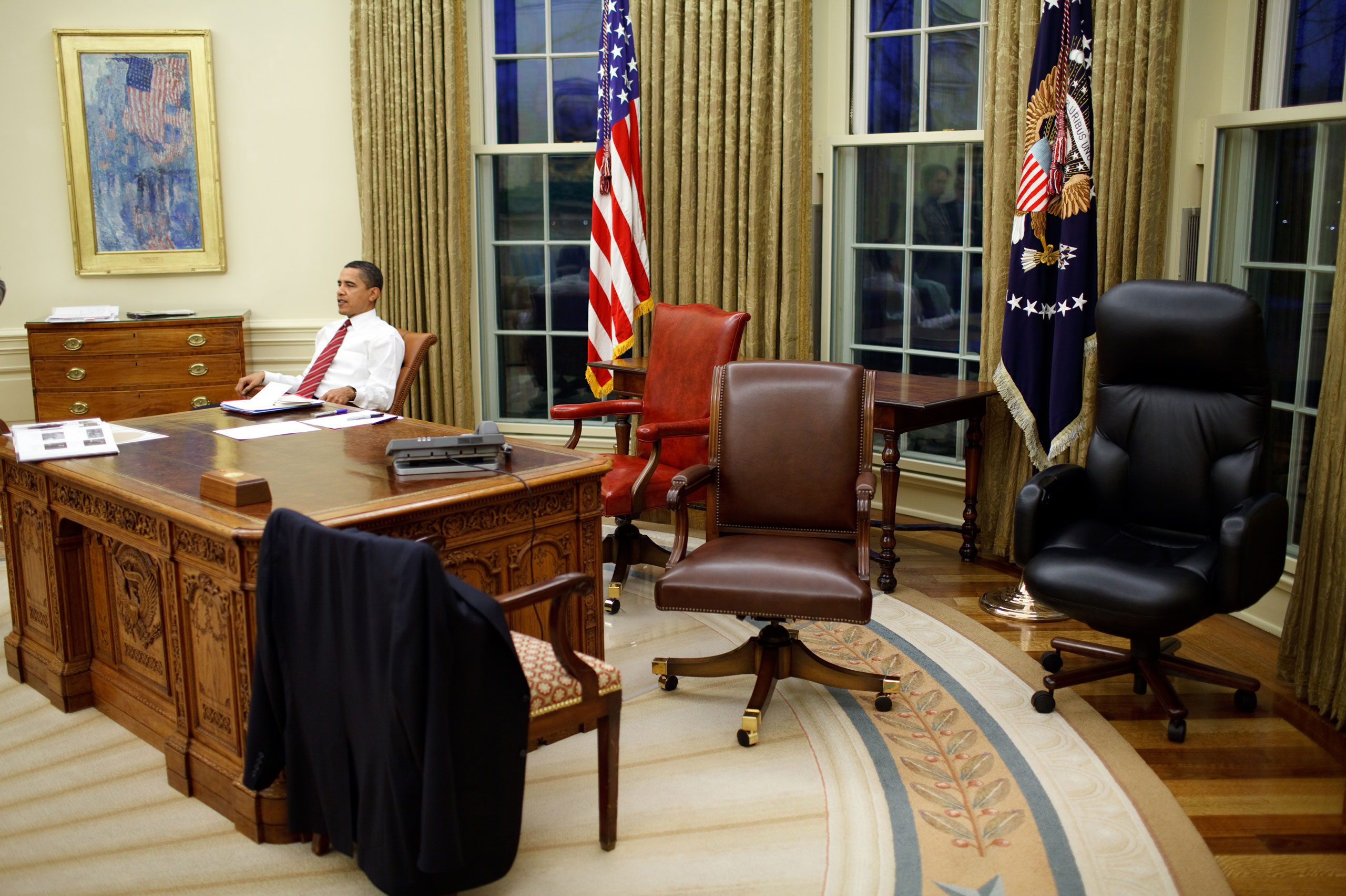 President Barack Obama tries out different desk chairs in the Oval Office, Jan. 30, 2009.