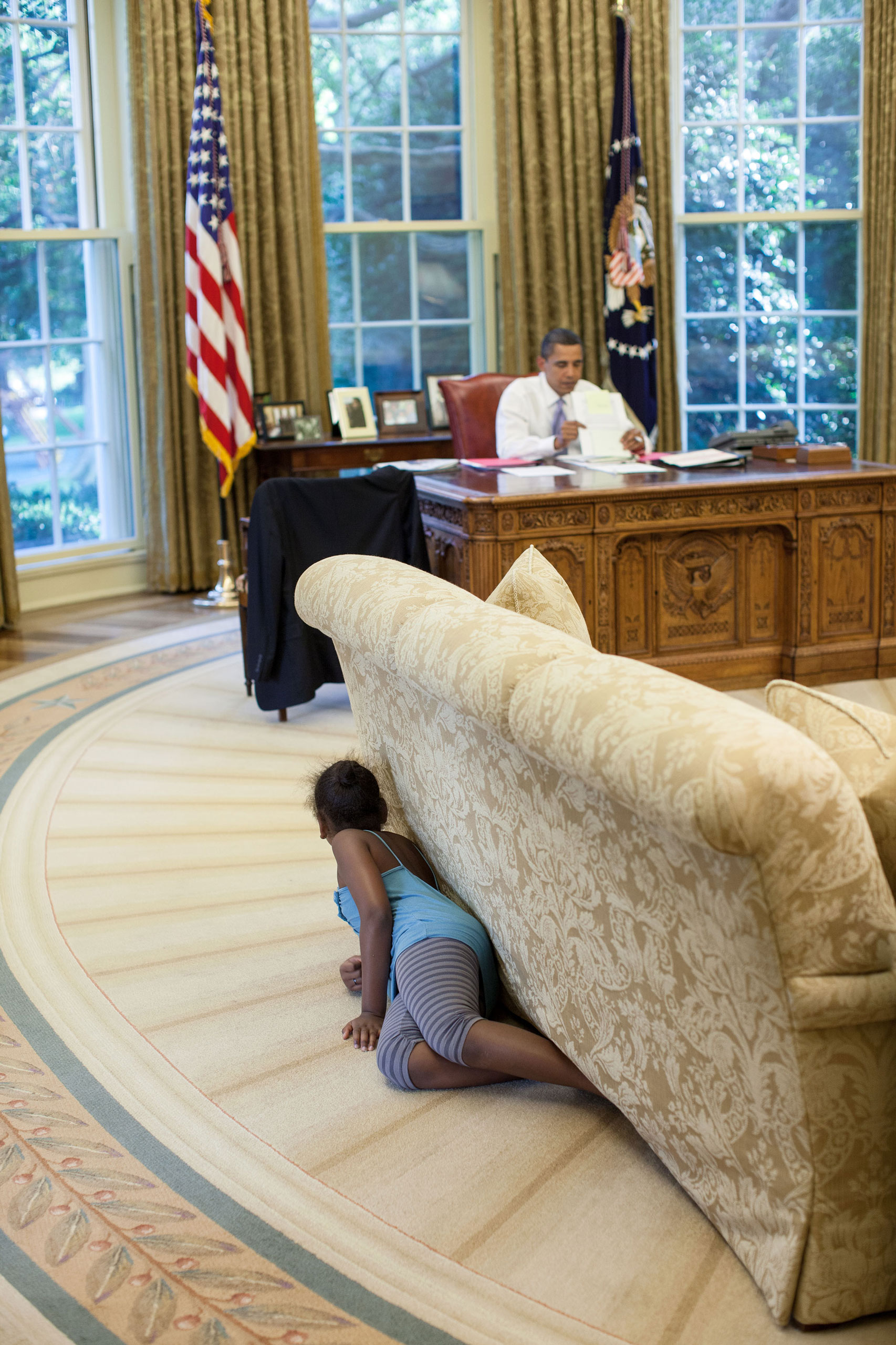 """""""I was sitting in the reception area outside the Oval Office on Aug. 5, 2009, when Sasha walked by and headed to the Oval. I suspected something was up, so I followed her. Sasha then crawled into the office, hiding behind the sofa, and when she reached the far end, jumped up and yelled, trying spook her dad."""""""
