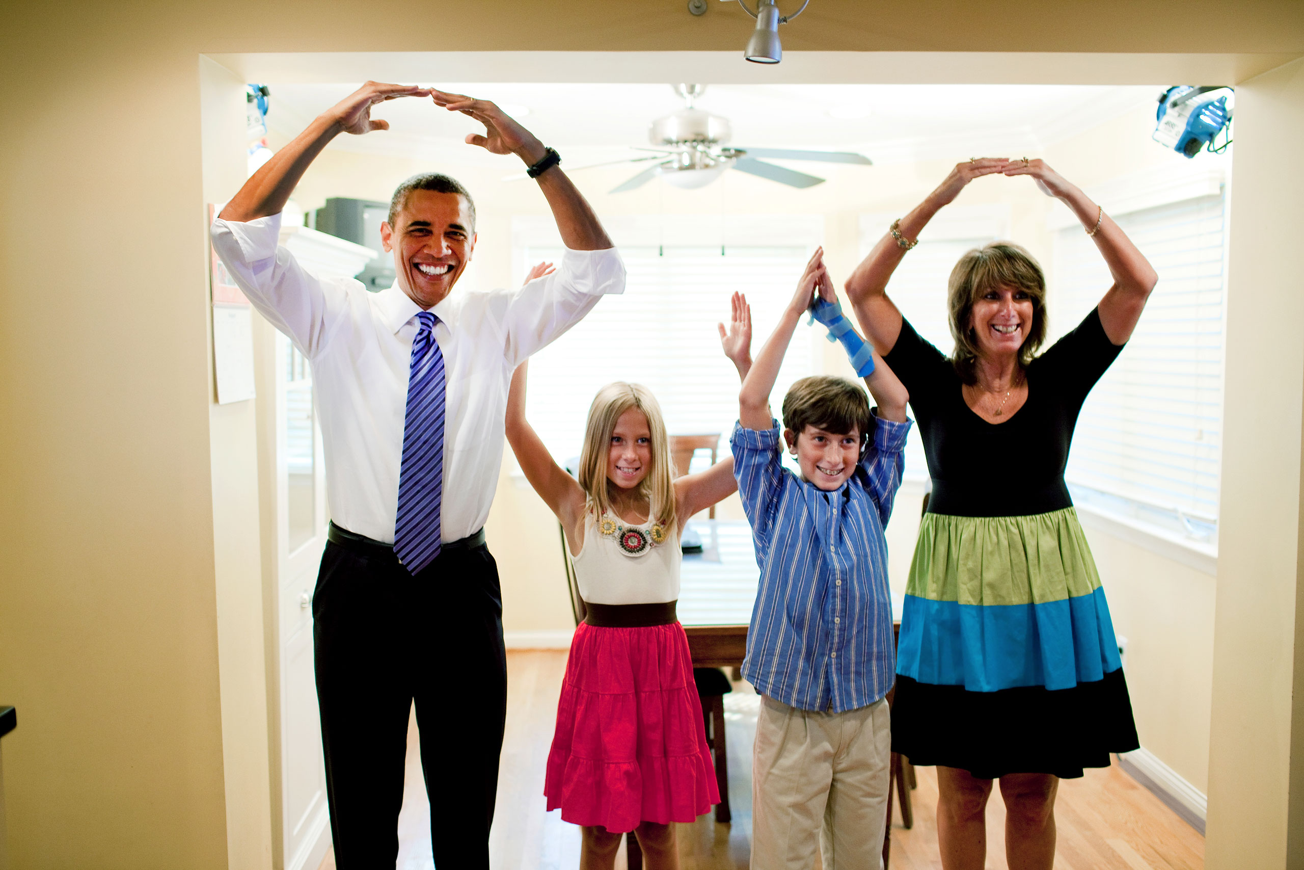 President Barack Obama helps spell out  Ohio  with the Weithman family, Rachel, 9, Josh, 11, and mom Rhonda, in their home in Columbus, Ohio, Aug. 18, 2010.