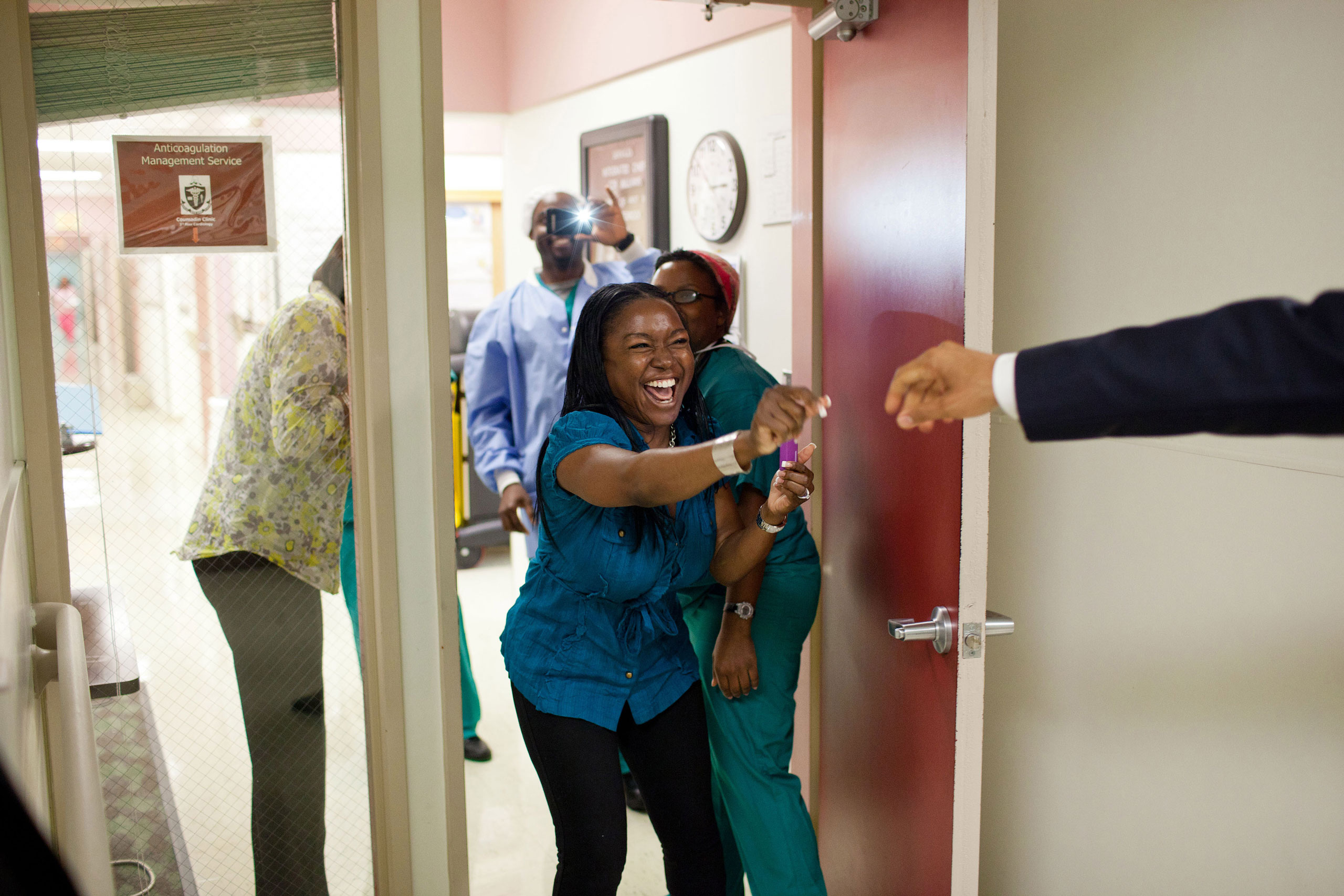 President Barack Obama greets hospital workers while visiting wounded service members at Walter Reed Army Medical Center in Washington, D.C., June 17, 2011.