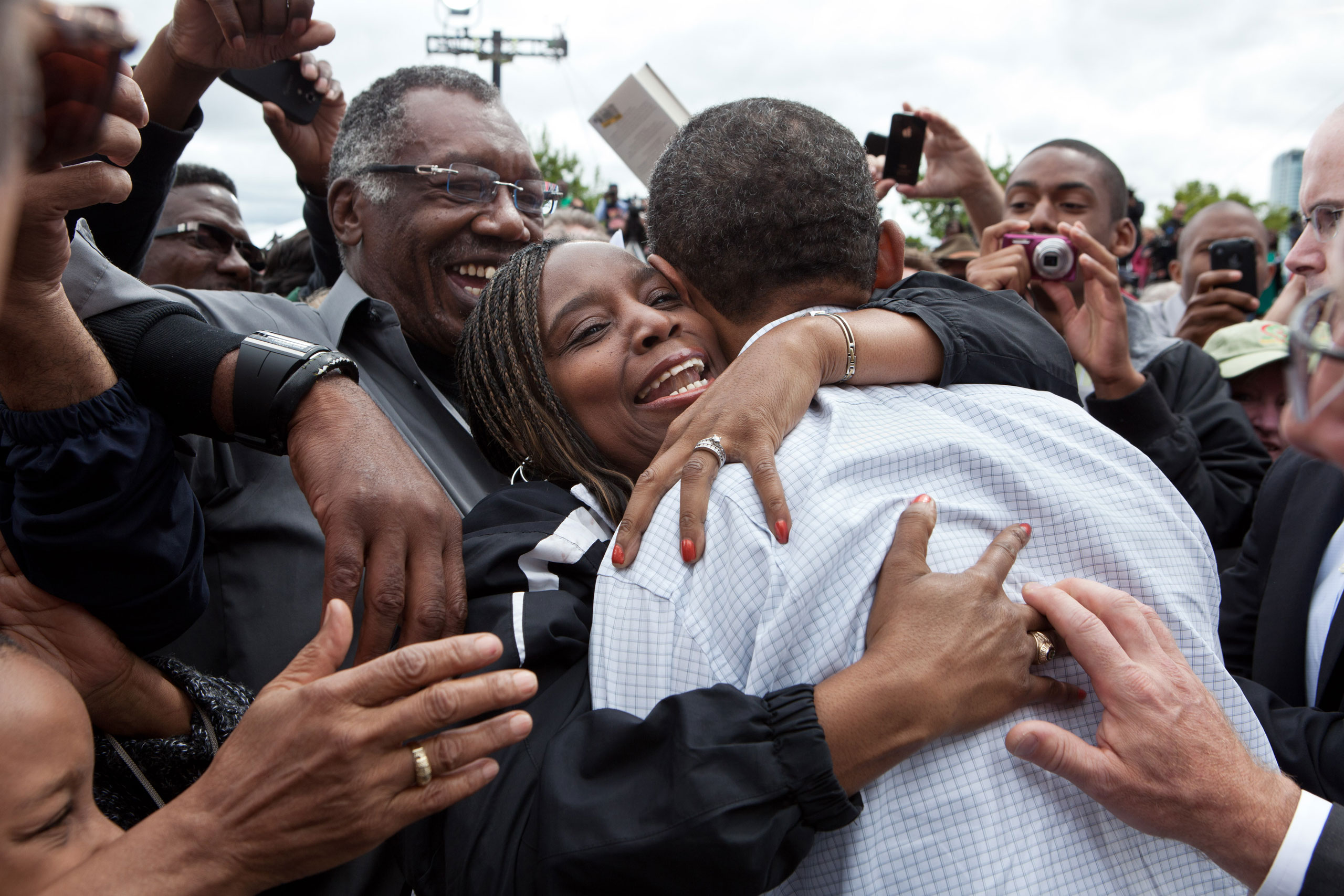 President Barack Obama hugs a woman in the crowd after addressing the Labor Day celebration in Detroit, Mich., Sept. 5, 2011.