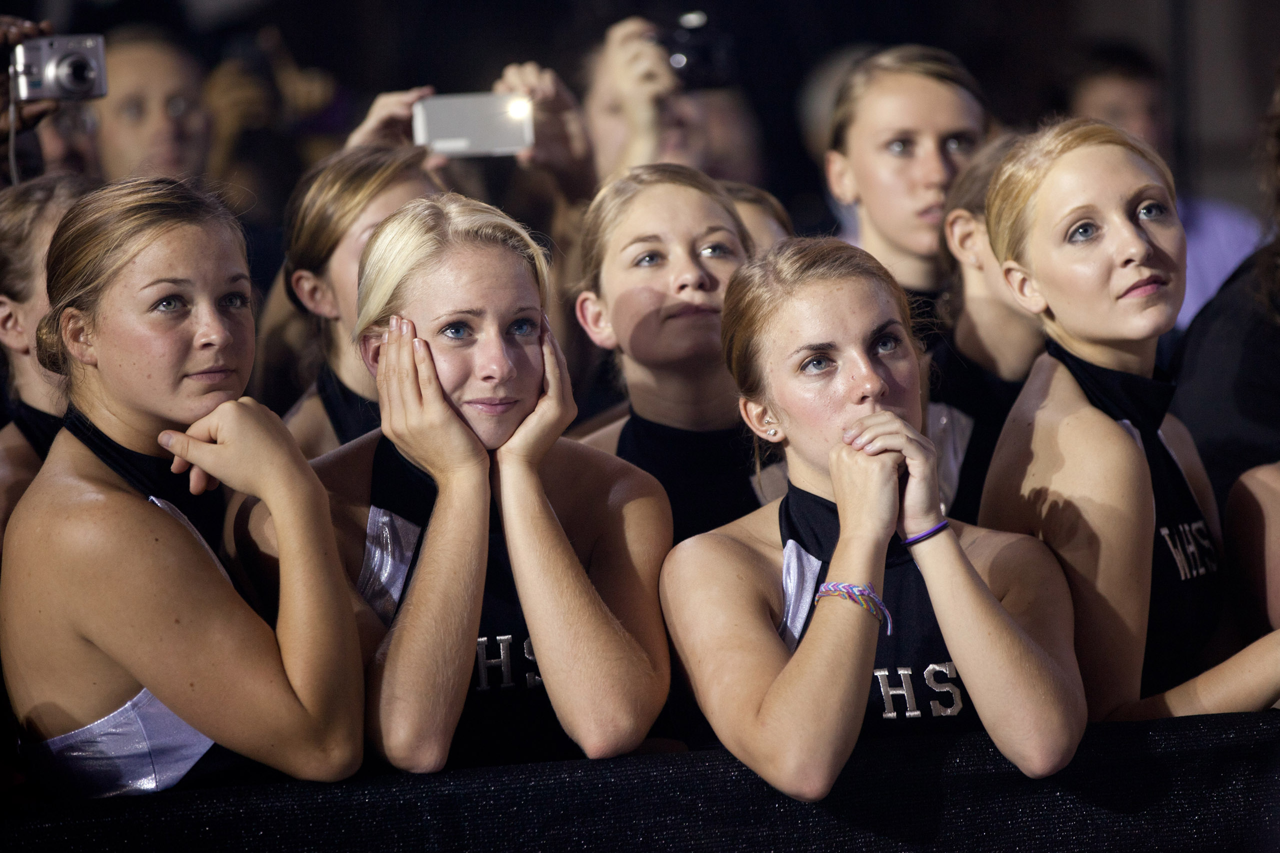 A group of high school cheerleaders listen in rapt attention as the President delivered remarks on the American Jobs Act at West Wilkes High School in Millers Creek, N.C,  Oct. 17, 2011.