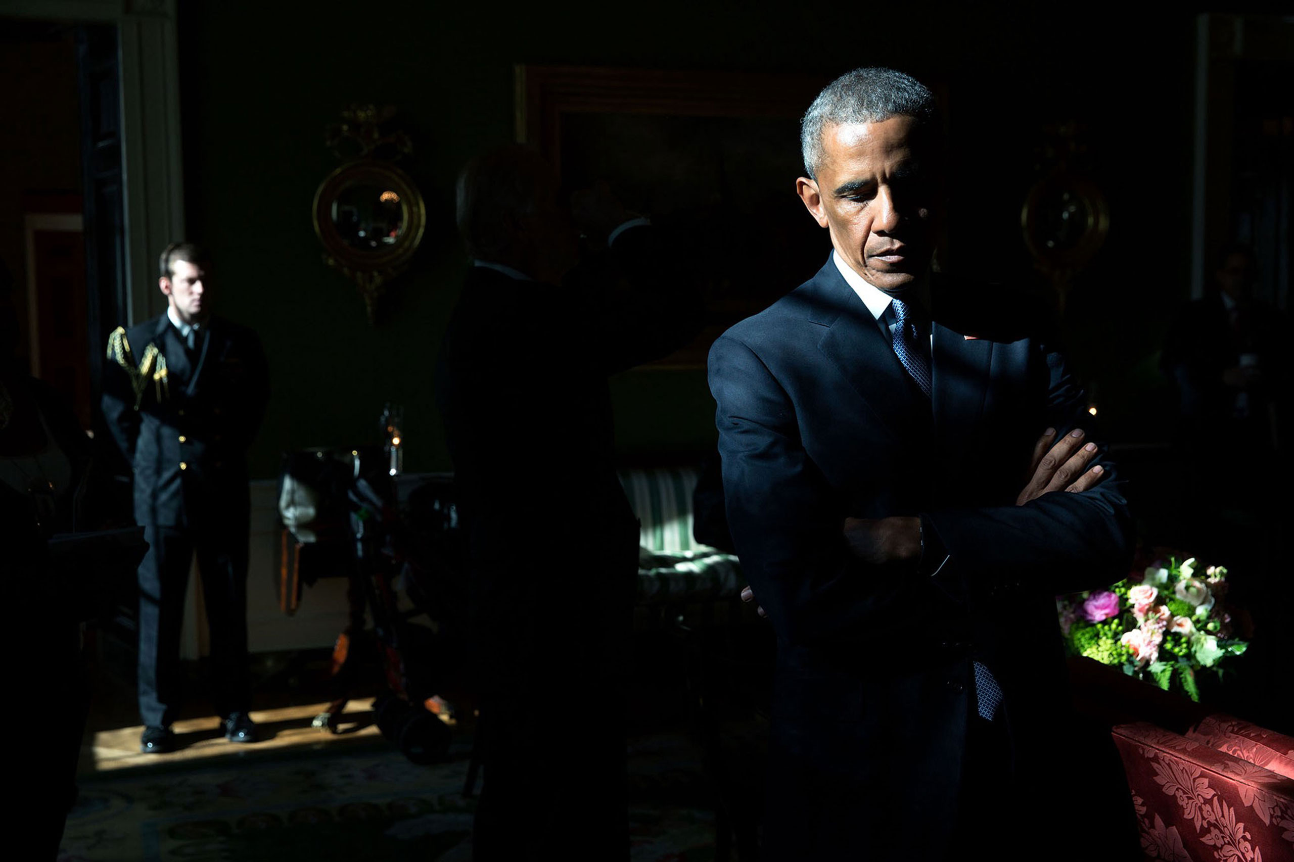 """""""With sunlight streaming through a window in the Green Room, President Obama listens to his introduction by Mark Barden, whose 7-year-old son Daniel was killed during the 2012 shooting at Sandy Hook Elementary School in Newtown, Conn. Later, as he made remarks in the East Room, he began to cry as he recalled the day of the shootings; he called it the worst day of his Presidency,  Jan. 5, 2016."""