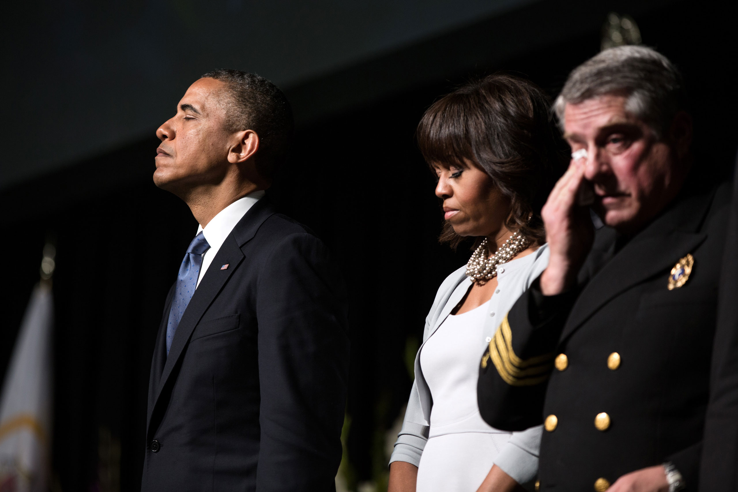 President Barack Obama and First Lady Michelle Obama pause during a memorial service for the victims of the fertilizer plant explosion in West, Texas, at Baylor University in Waco, Texas, April 25, 2013. Fire Chaplain Jimmy Duncan stands with the President and Mrs. Obama.