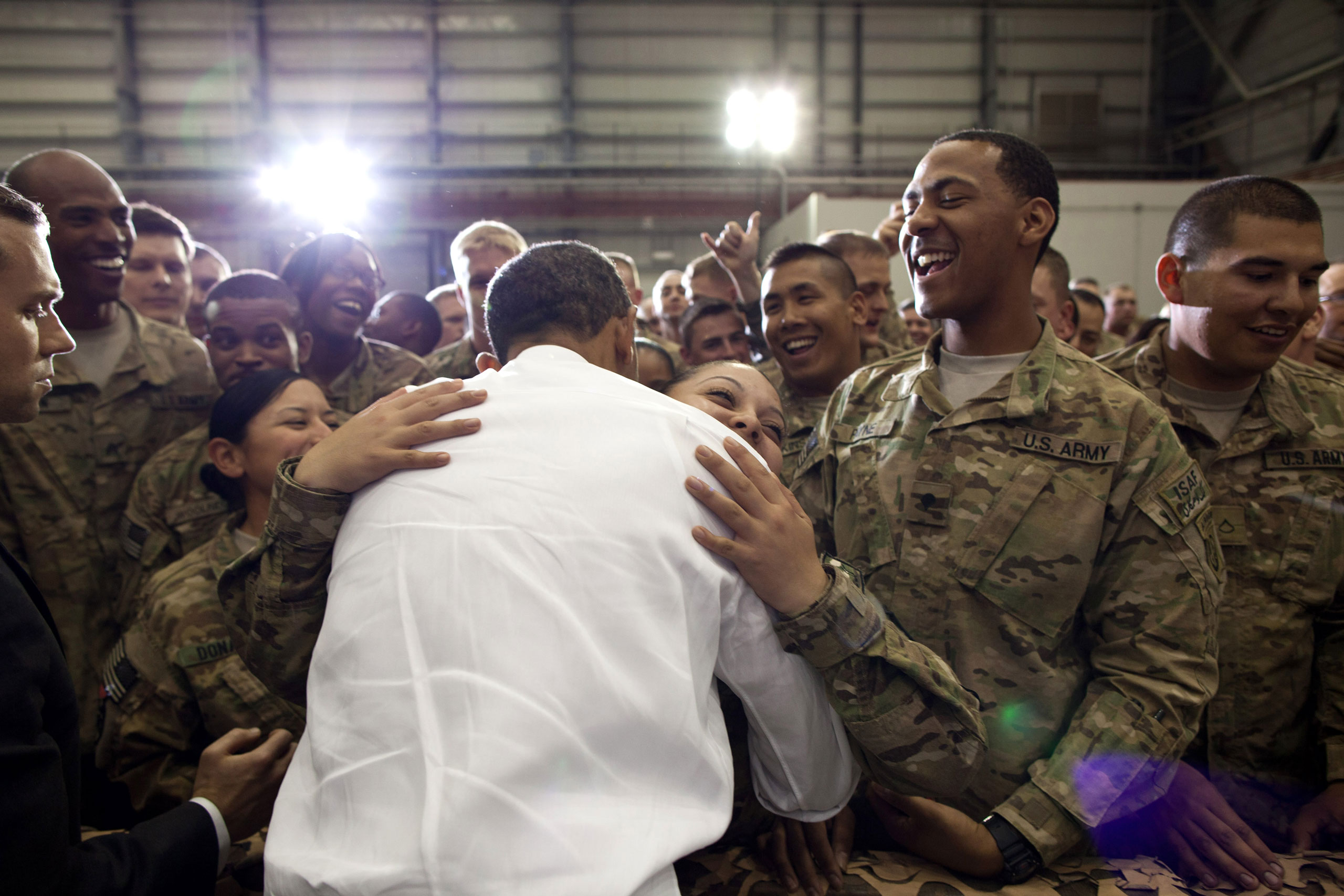 President Obama greets U.S. troops following his remarks during an unannounced trip to Bagram Air Field, Afghanistan, May 1, 2012. The President made three trips around the ropeline to try and shake every hand.