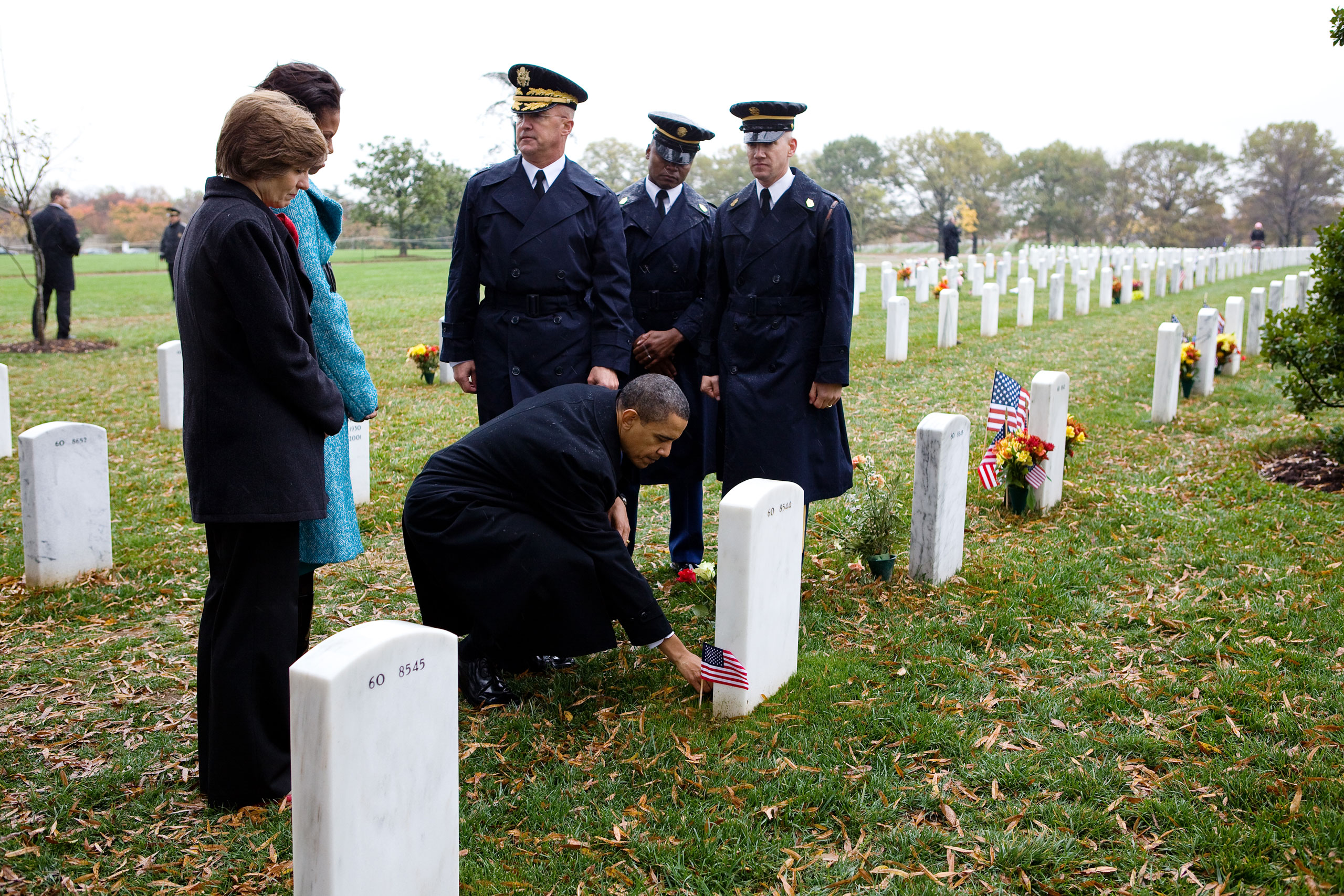 """""""He was at Arlington National Cemetery for Veterans Day, and after his remarks, made an impromptu stop at Section 60, where troops from Afghanistan and Iraq are buried. He paused to leave a Presidential coin in front of the tombstone for 19-year-old Medal of Honor recipient Specialist Ross McGinnis. Later that same day, the President held a briefing in the Situation Room on Afghanistan,  Nov. 11, 2009."""