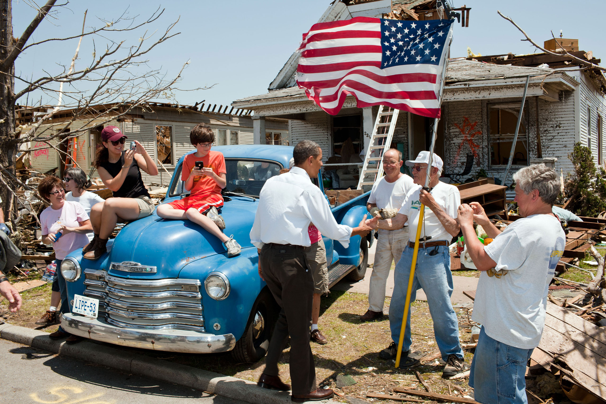 The President visits Joplin, Mo., on May 29, 2011, following a devastating tornado. Here he greets Hugh Hills, 85, in front of his home. Hills told the President he hid in a closet during the tornado, which destroyed the second floor and half the first floor of his house.